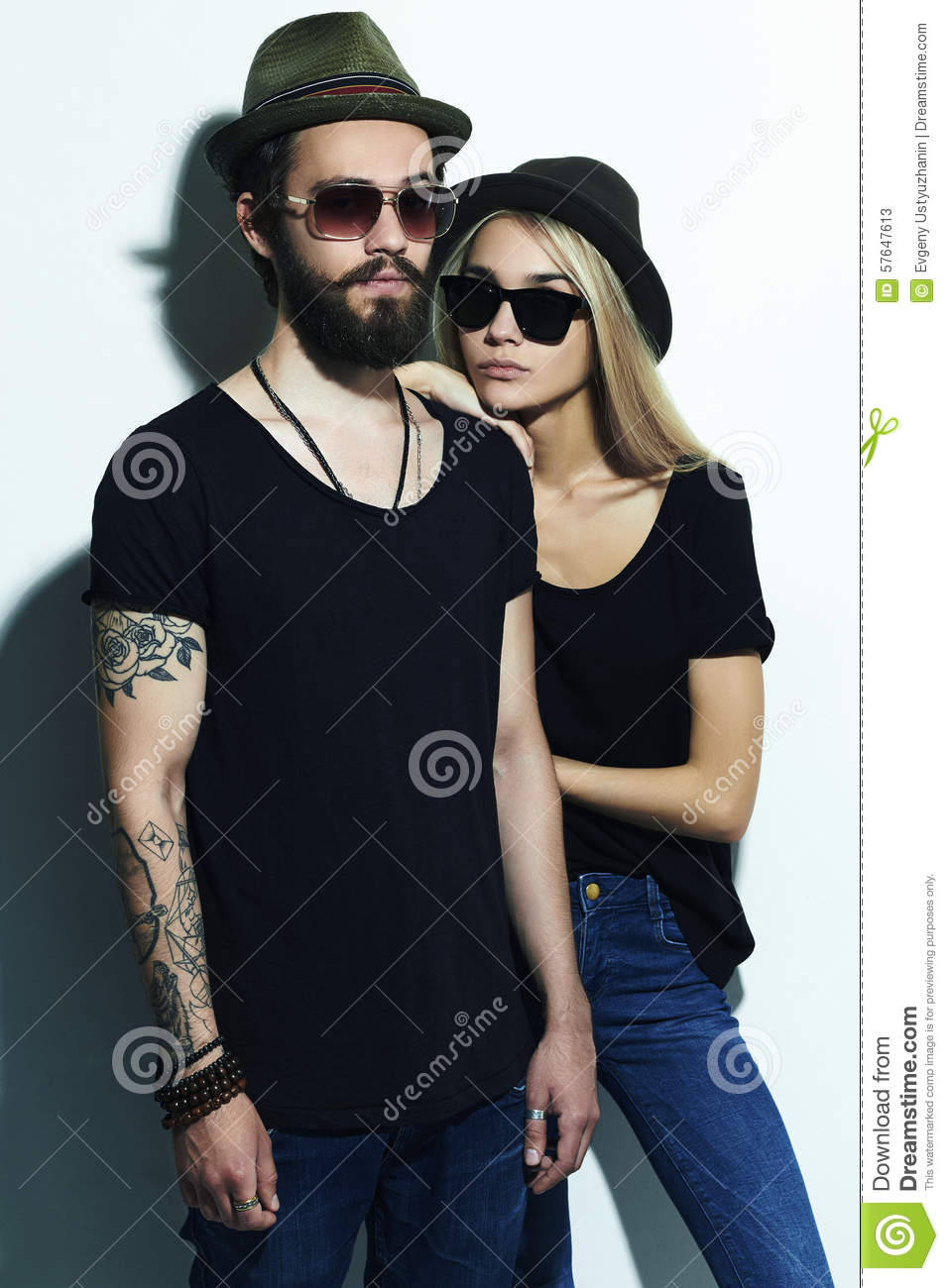 fashion beautiful couple in hat together hipster boy and