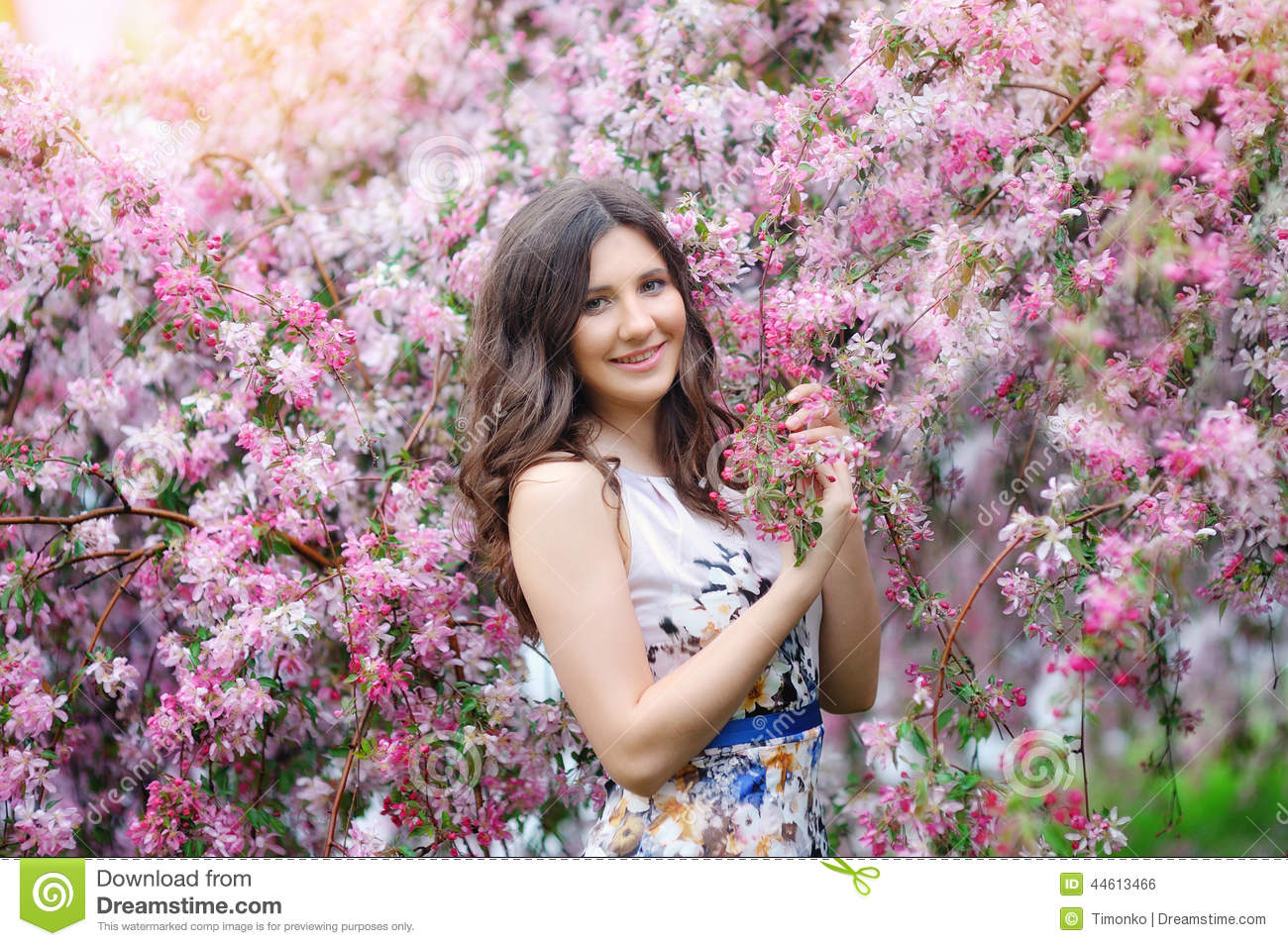 Fashion Beautiful Girl In A Flowers Garden Stock Photo