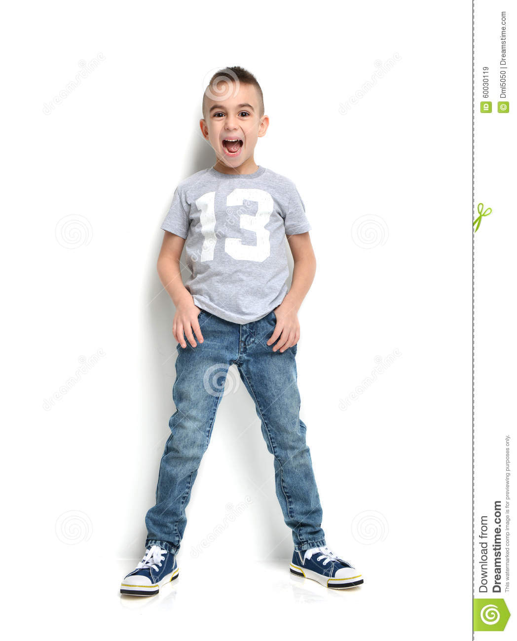 fashion beautiful little boy in tshirt jeans standing and