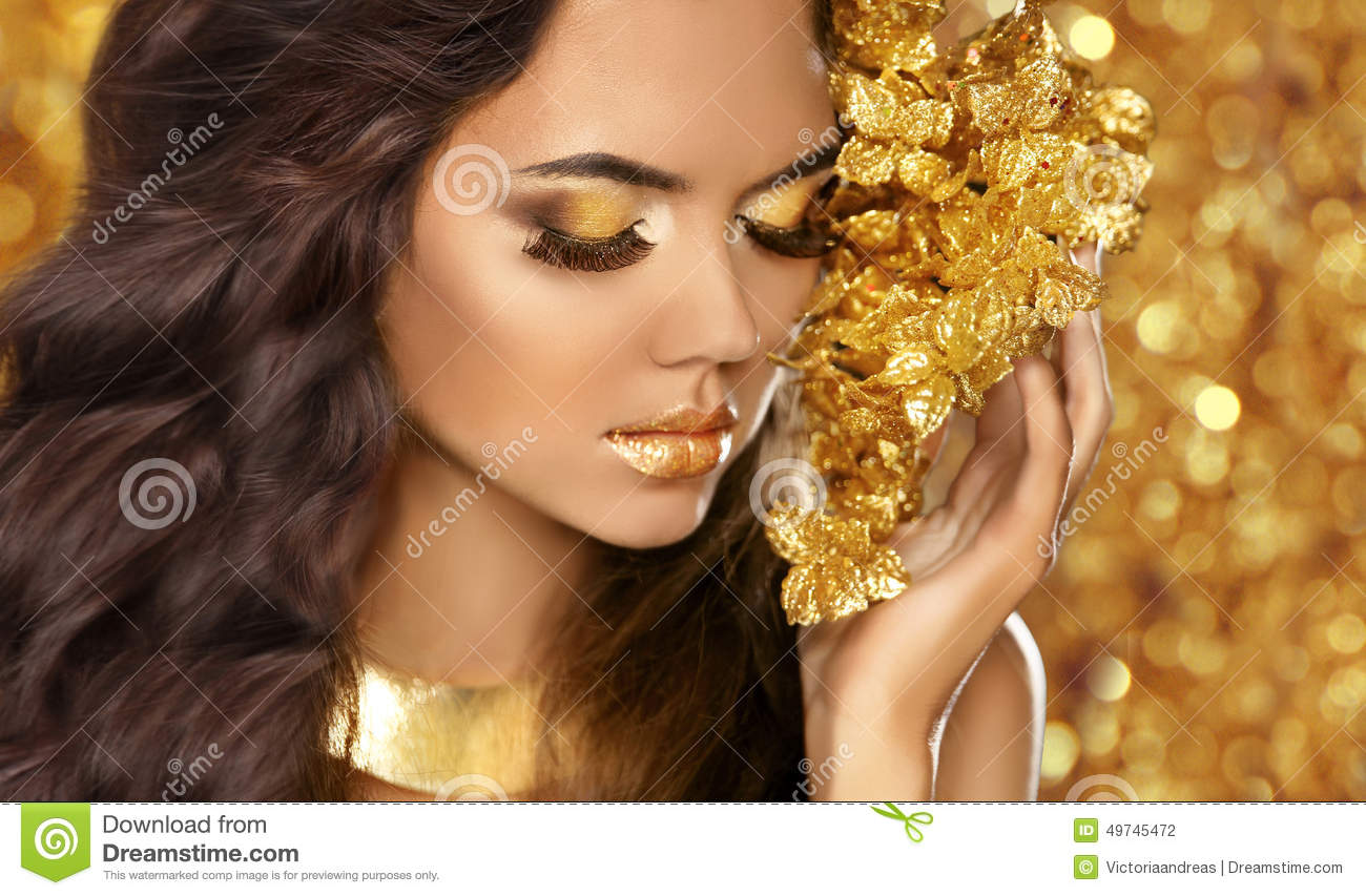 Fashion Beauty Girl Portrait. Eyes Makeup. Golden Jewelry