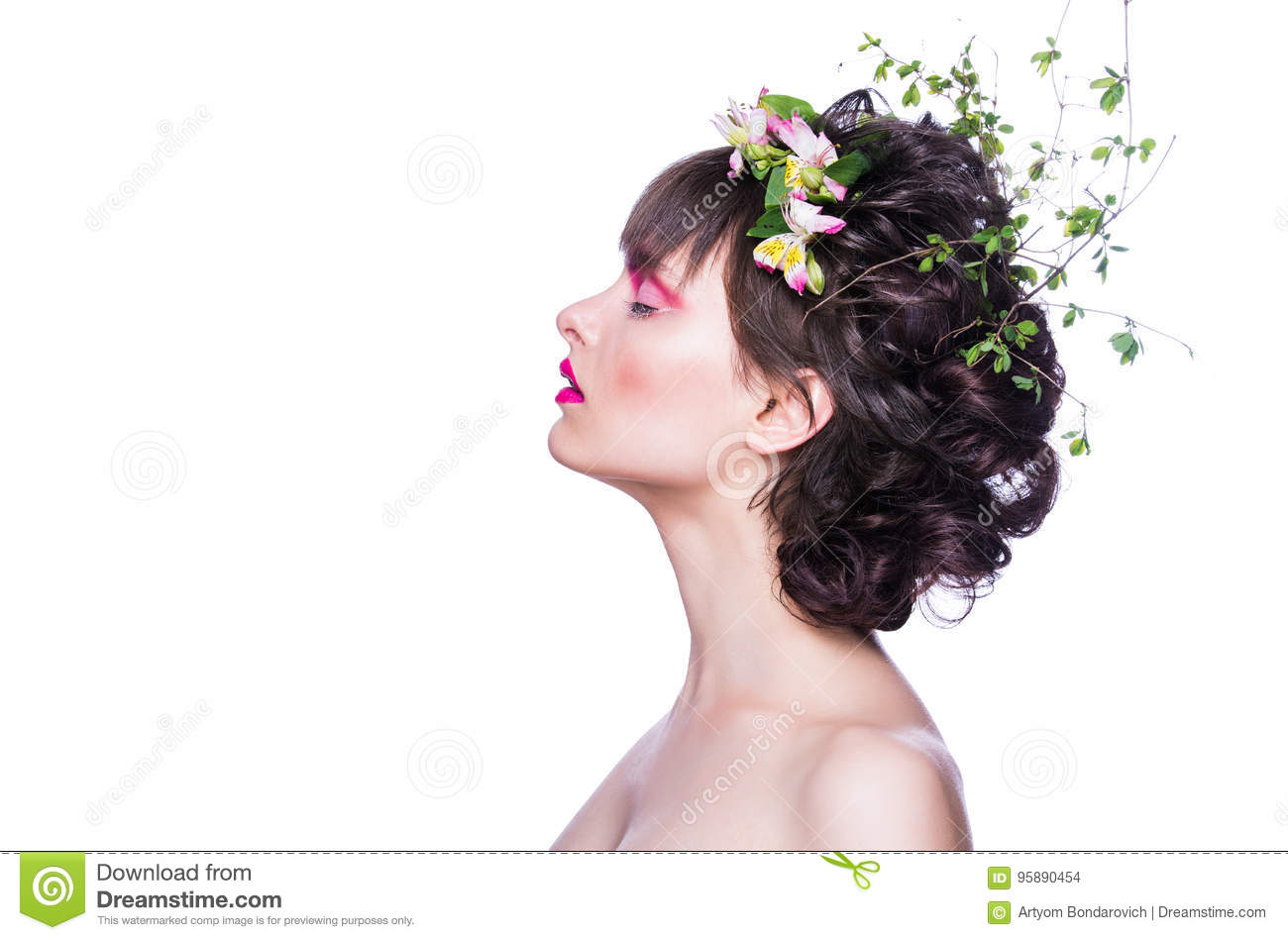 Fashion beauty model girl with a chaplet from flowers in hair. Creative makeup and hairstyle.