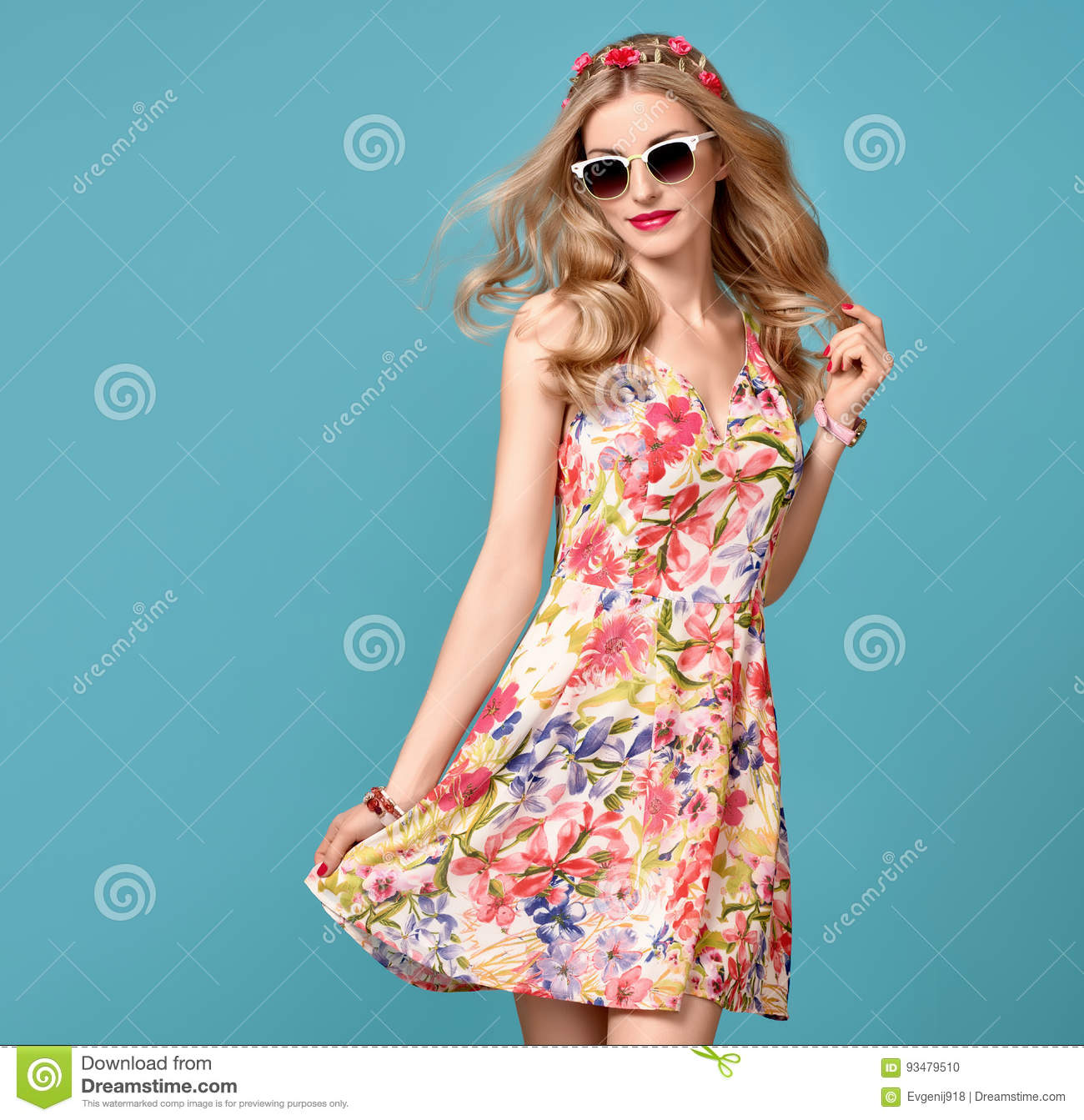 b4bd4c0695 Fashion Beauty. Sensual Blond Model in fashion pose Smiling. Woman in Summer  Outfit. Trendy Floral Dress