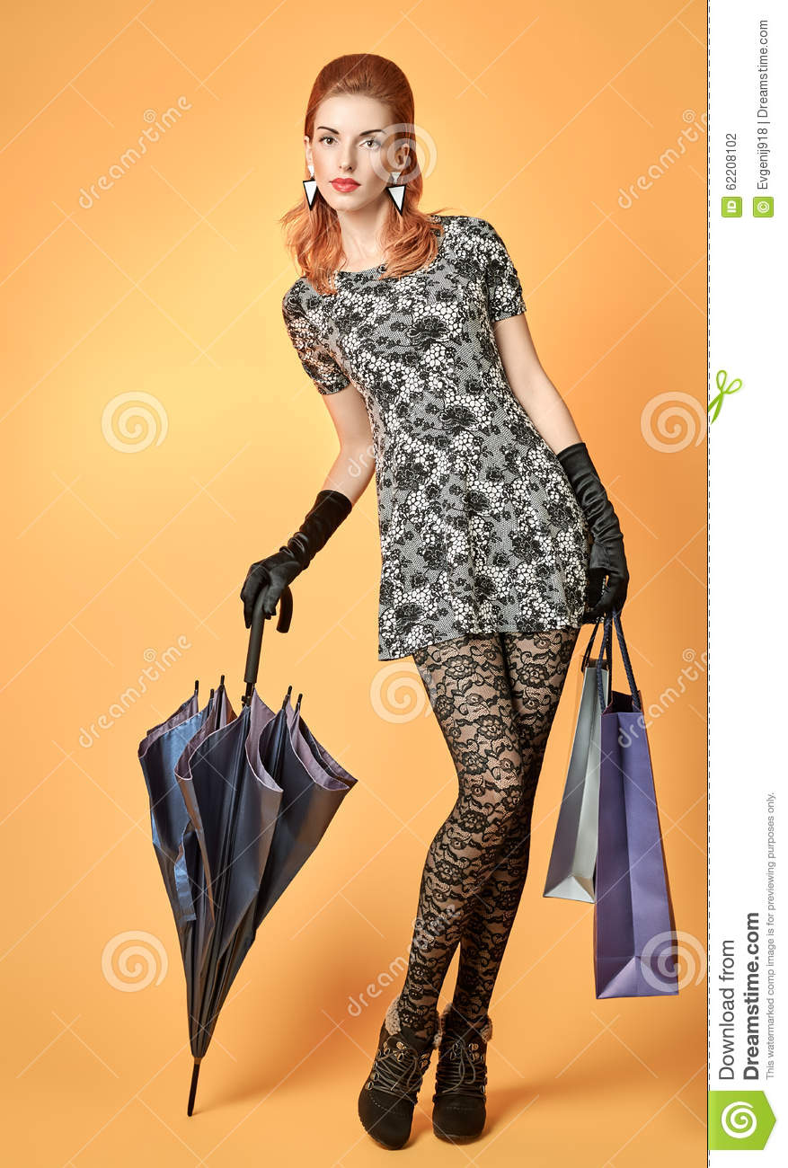Fashion Beauty Woman Holding Shopping Bags.Vintage Stock
