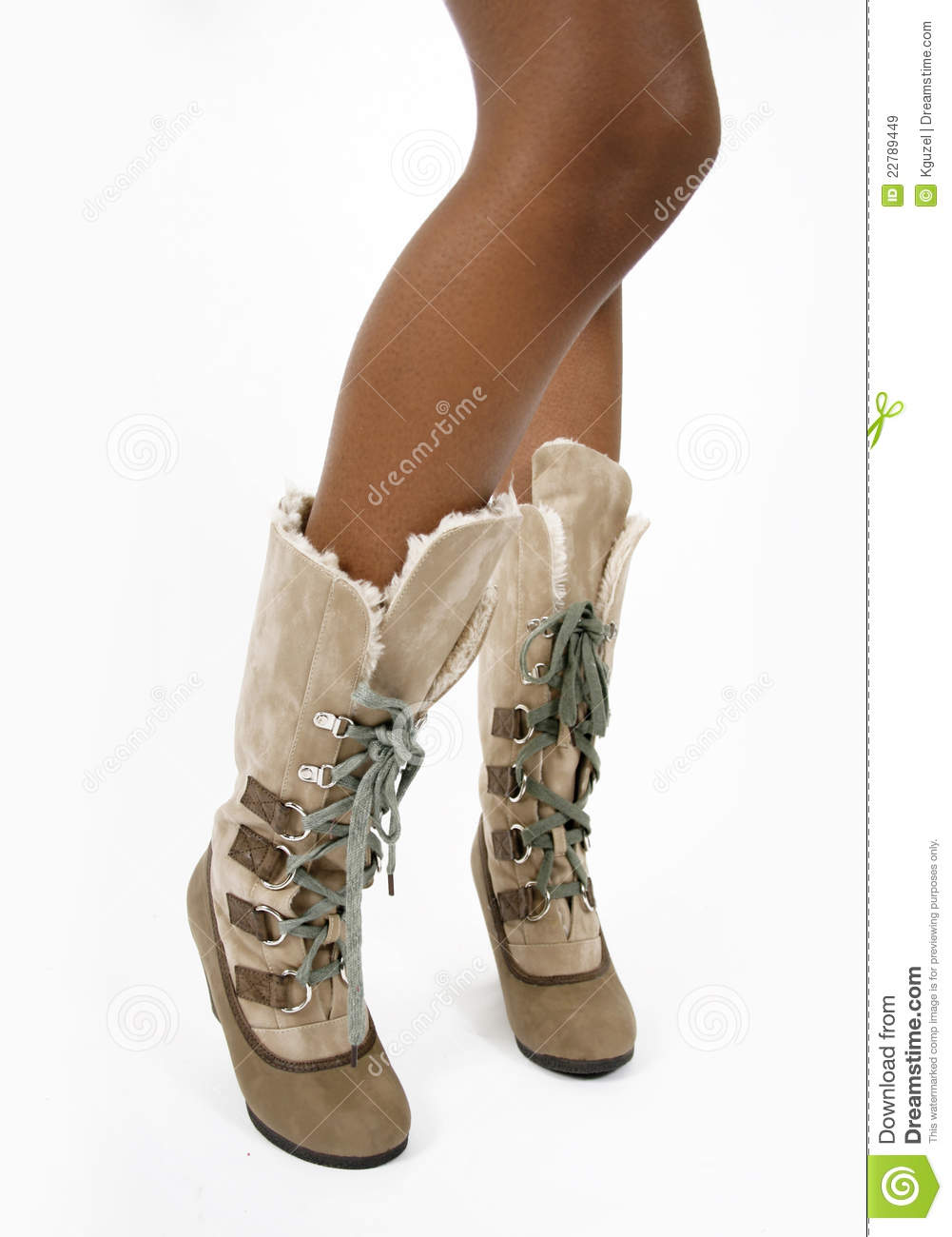 stock images of ` Fashion beige fur women s boots on a sexy legs