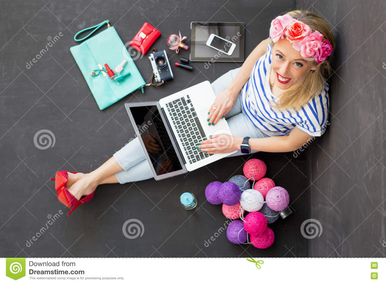 Fashion blogger with computer looking up