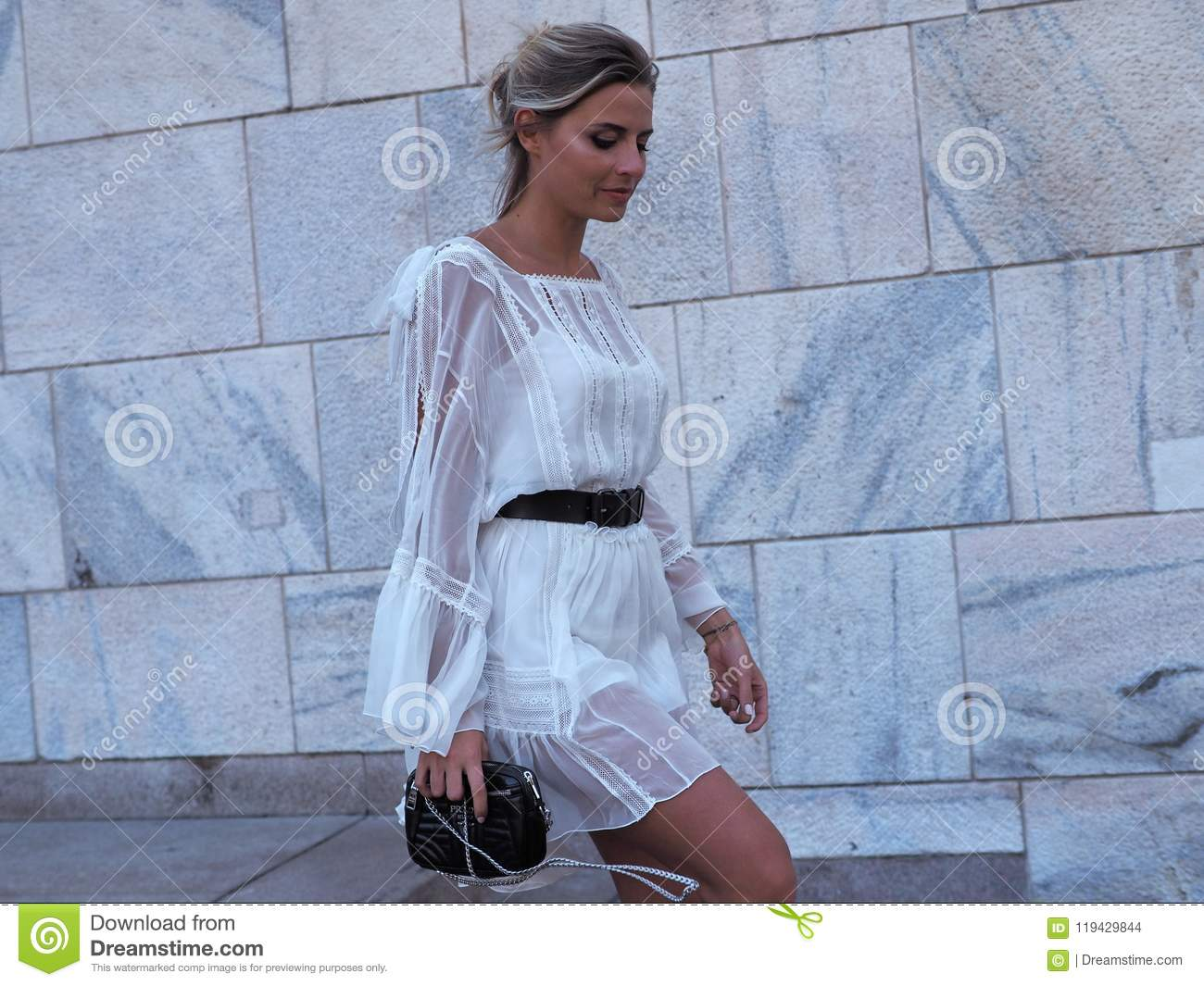 MILAN, ITALY -JUNE 15, 2018: Veronica Ferrero posing for photographers in the street after ALBERTA FERRETTI fashion show