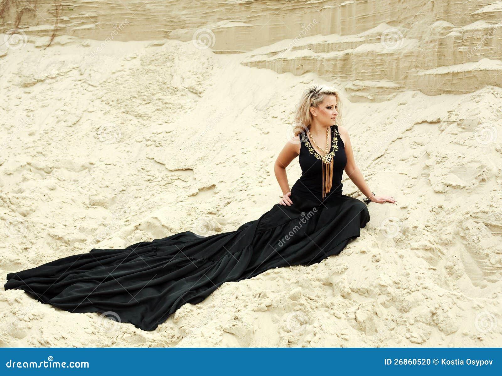 Portrait of young beautiful blonde woman wearing a long