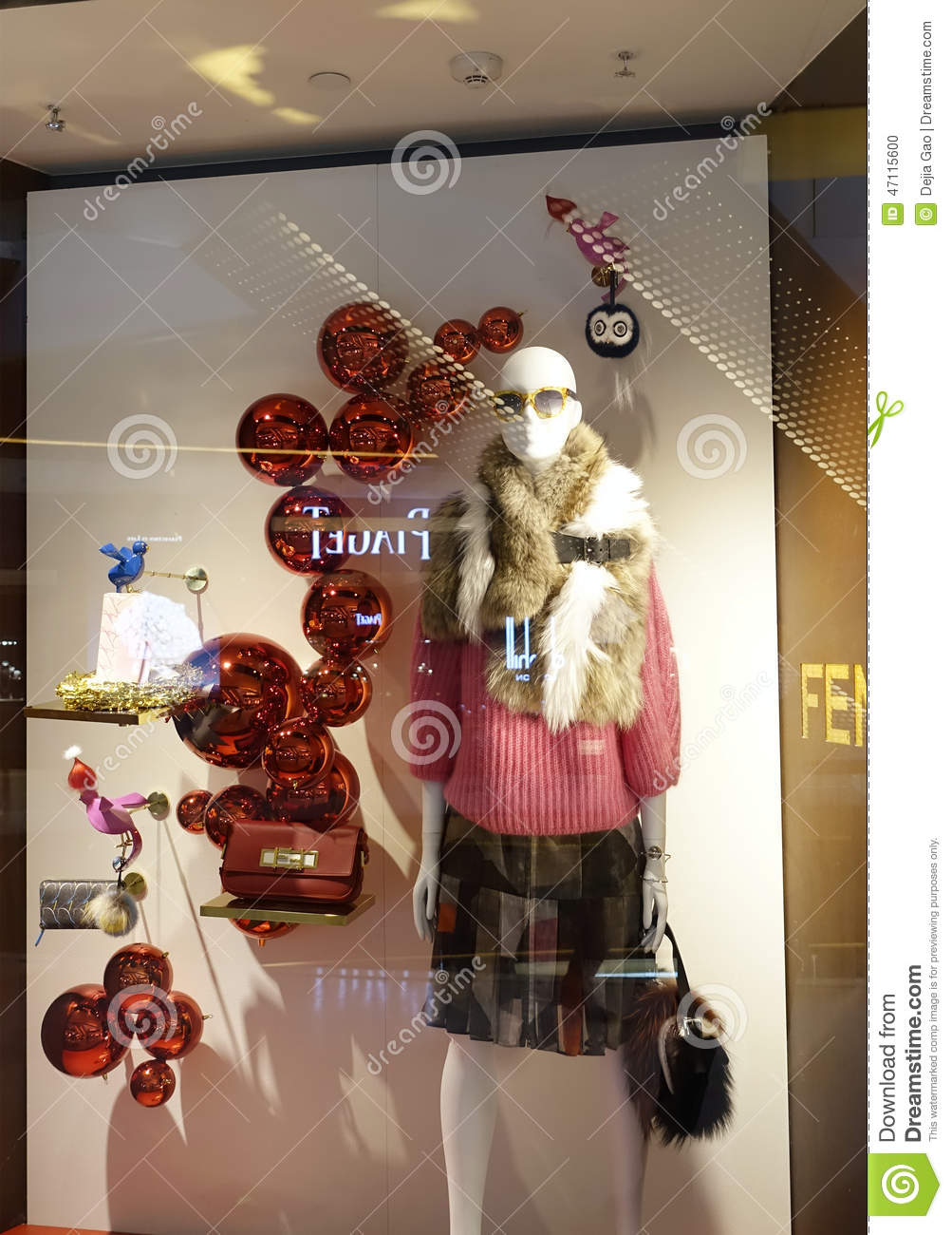 0783eaf86dbad Modern woman boutique clothes retail shop window front. Fashion clothing  store sale display with women female mannequin in shopping mall.