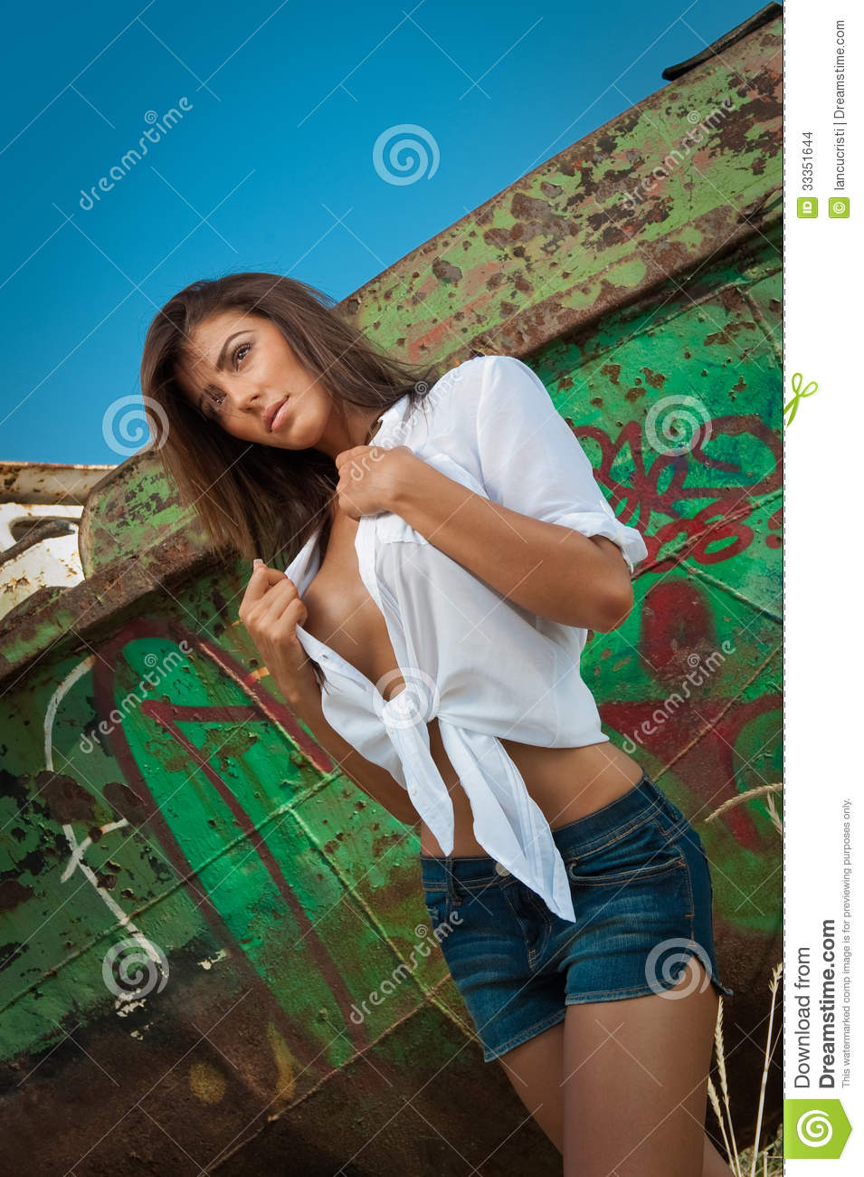 Fashion Caucasian Model Posing Outdoor In Front Of An Old ...