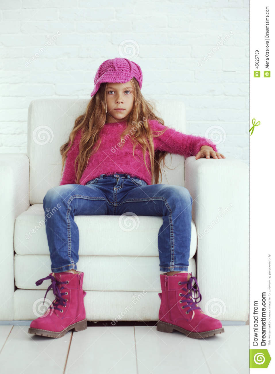 Cute pre-teen girl wearing fashion winter clothes posing in white ...