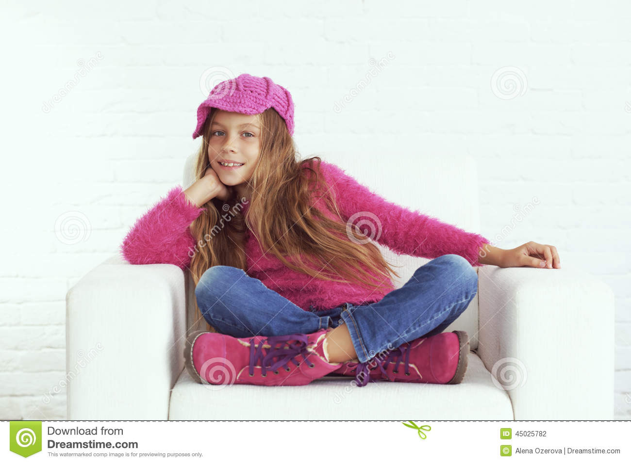 cute pre teen girl wearing fashion winter clothes posing in white