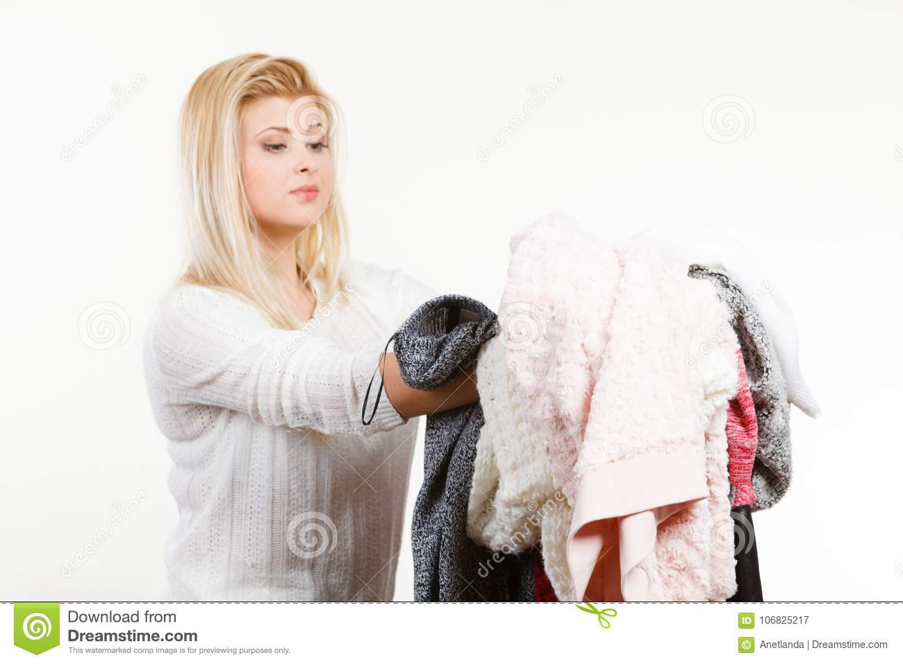 Newspaper Readers Winter Dilemma >> Woman Holding Many Clothing Stock Image Image Of Fashion