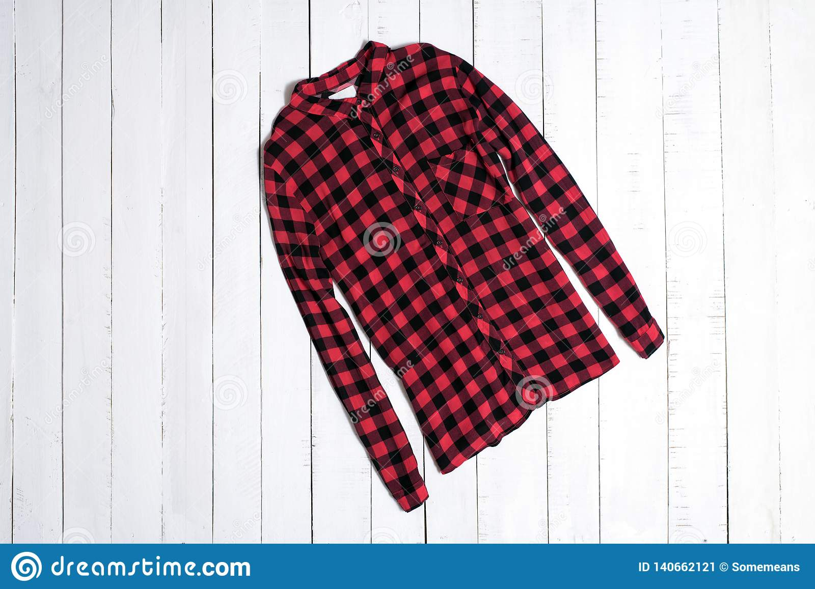 Fashion Clothes  Red Checkered Shirt On White Wooden Floor Planks