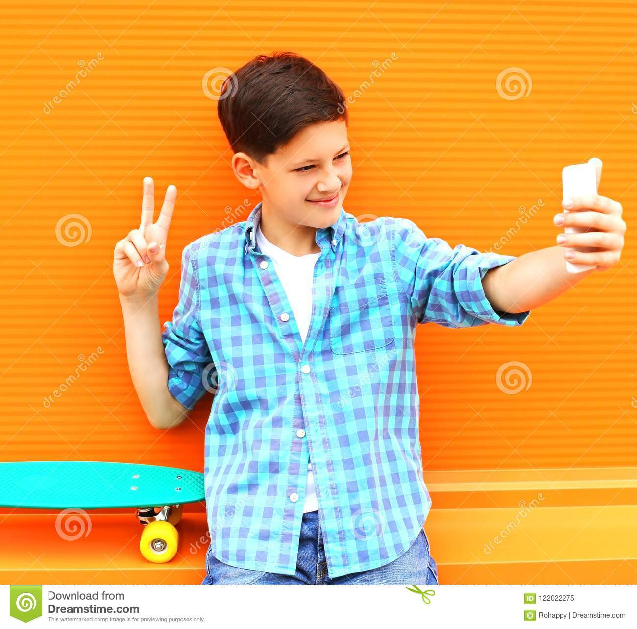 Fashion cool teenager boy is taking picture self portrait