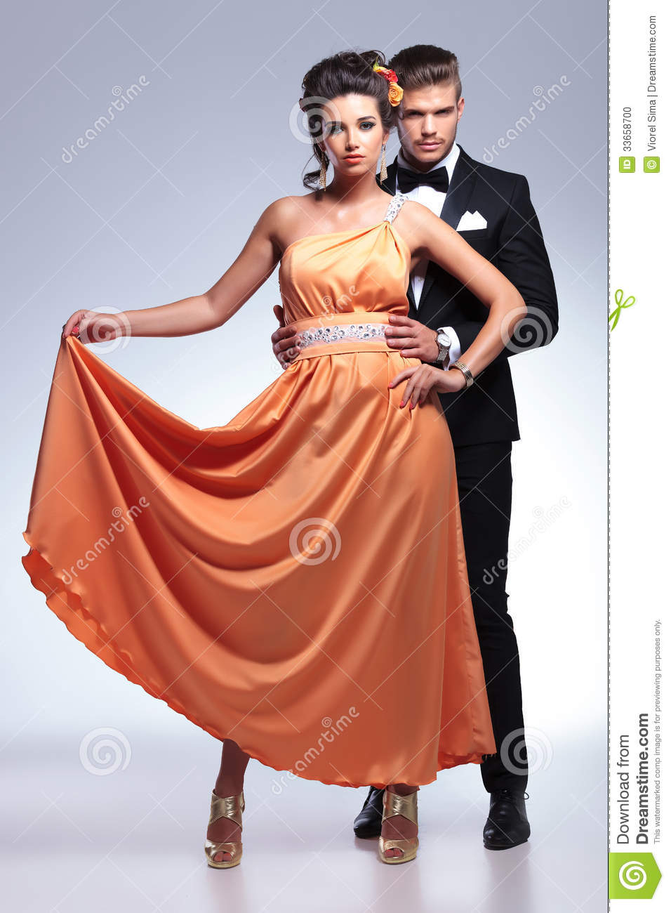 Fashion couple with woman holding up her dress stock photo image 33658700 Fashion style dress up