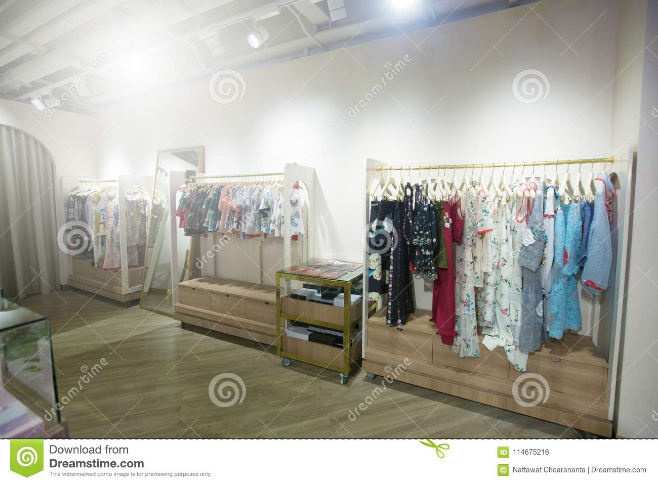 Fashion Design Clothes On Display Rack In Retail Shop Stock Photo Image Of Basic Female 114675216