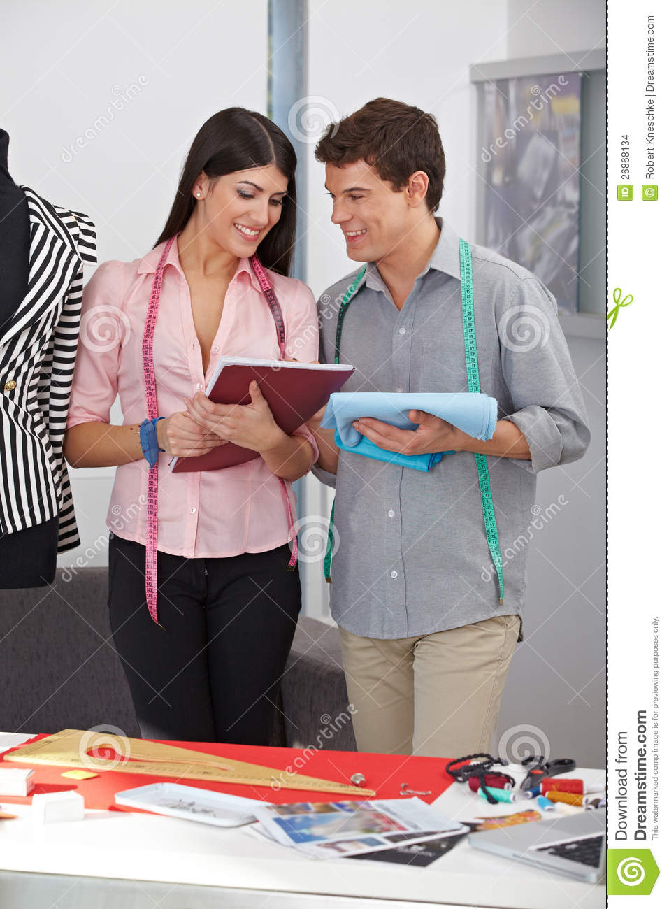 fashion designer with assistant stock photo image of measure