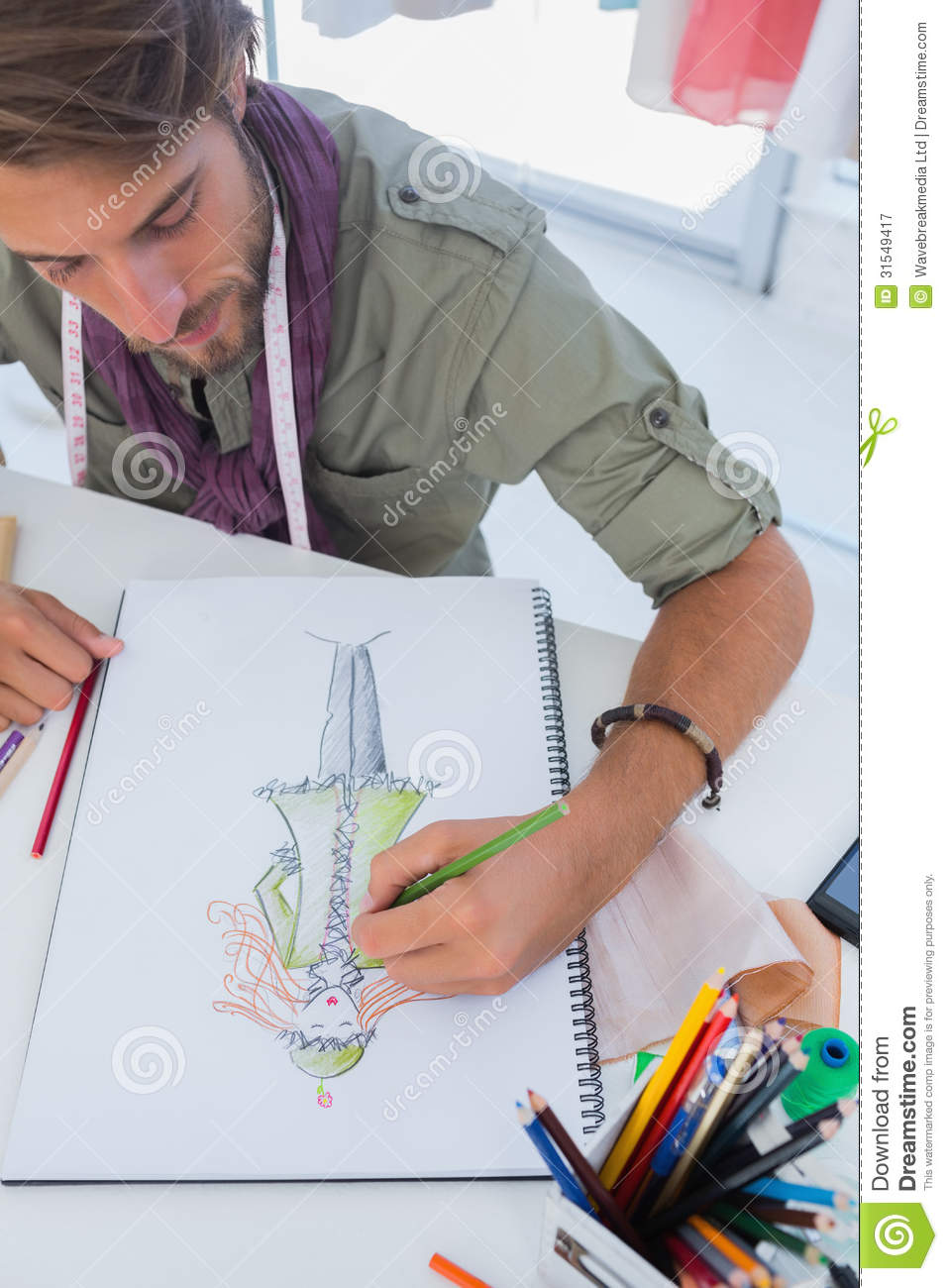 Fashion designer drawing a coat royalty free stock Contemporary fashion designers