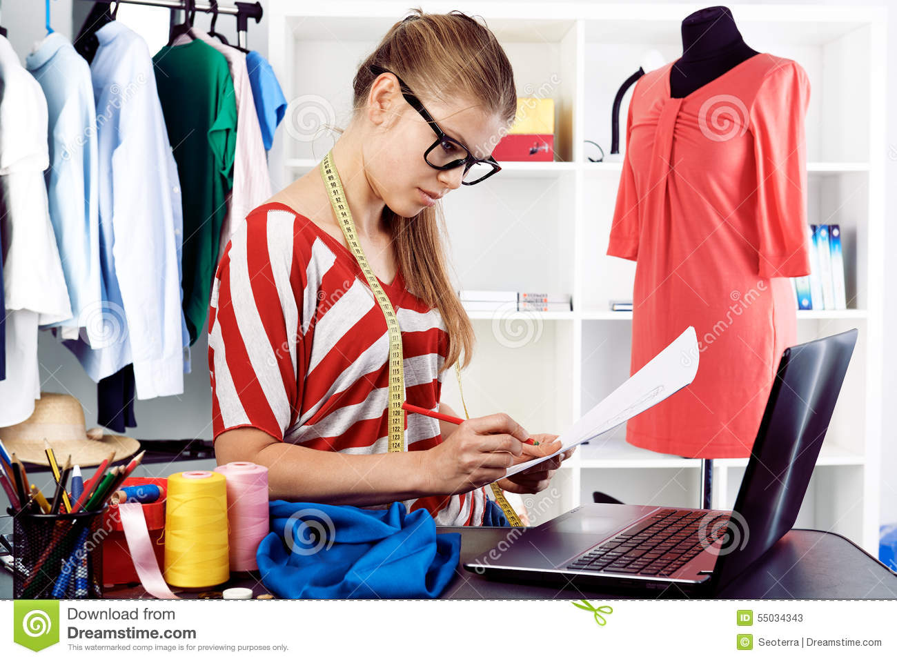 Fashion designer stock image. Image of computer, material