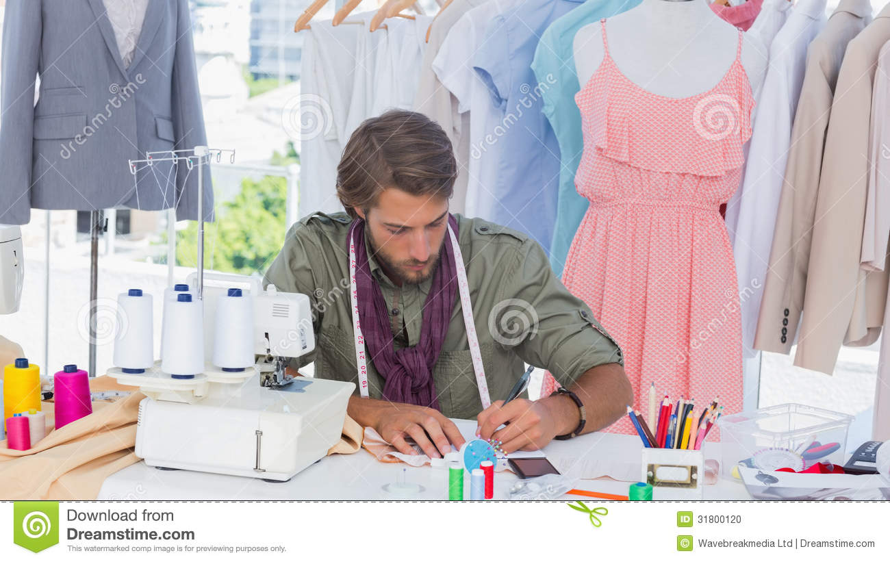 Fashion designer drawing on a desk stock photo image of Contemporary fashion designers