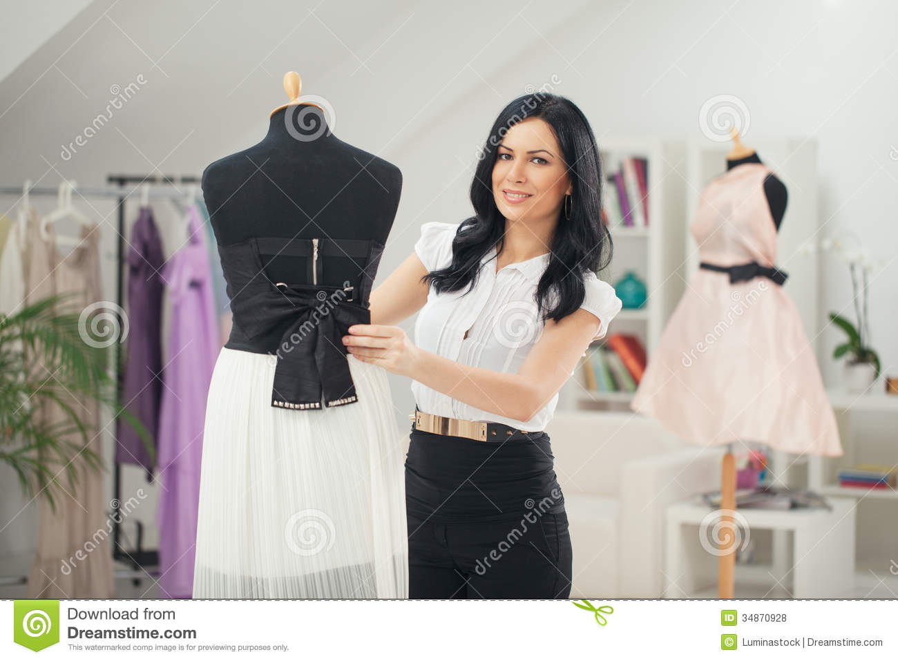 Fashion designer at her studio royalty free stock photos Contemporary fashion designers