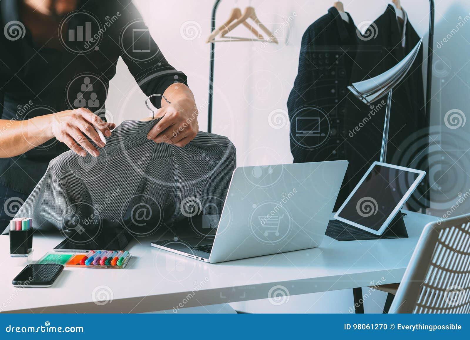 Fashion Designer Holding Shirt And Using Laptop With Digital Tab Stock Photo Image Of Background Desk 98061270