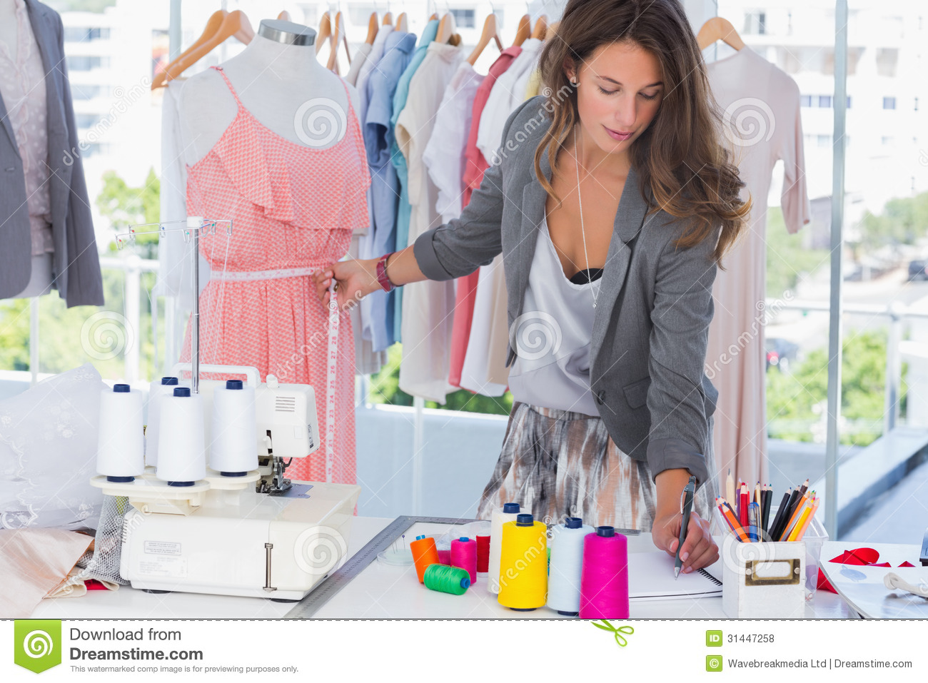 Fashion Designer Measuring A Mannequin Royalty Free Stock