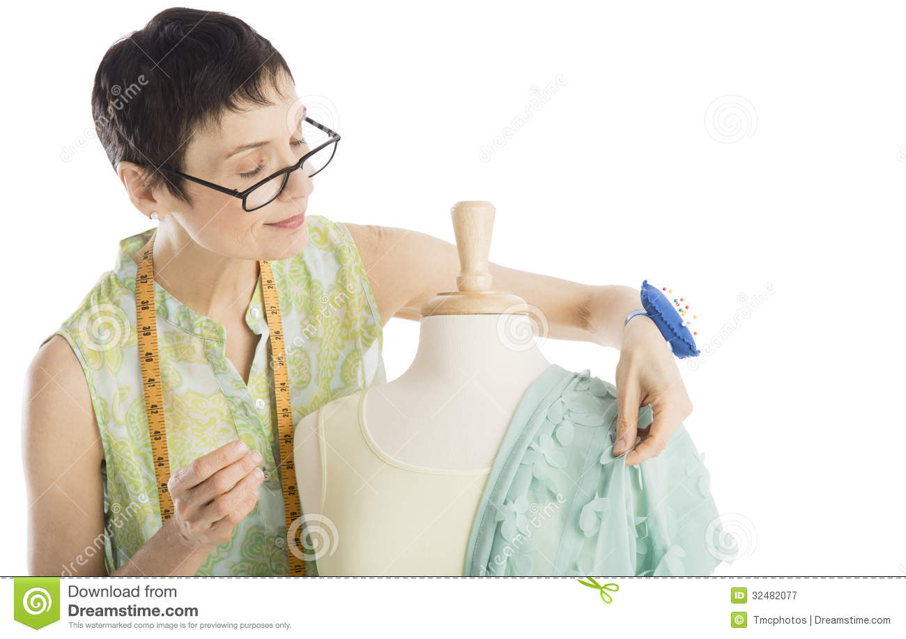 Fashion Designer Pinning Clothes To Mannequin Royalty Free