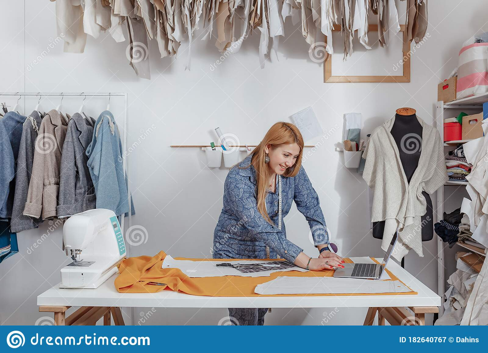 Fashion Designer Pinning Fabric Cutouts Professional Dressmaker At Work Tailor Cutting A Textile At Workbench Stock Image Image Of Damaged Empty 182640767
