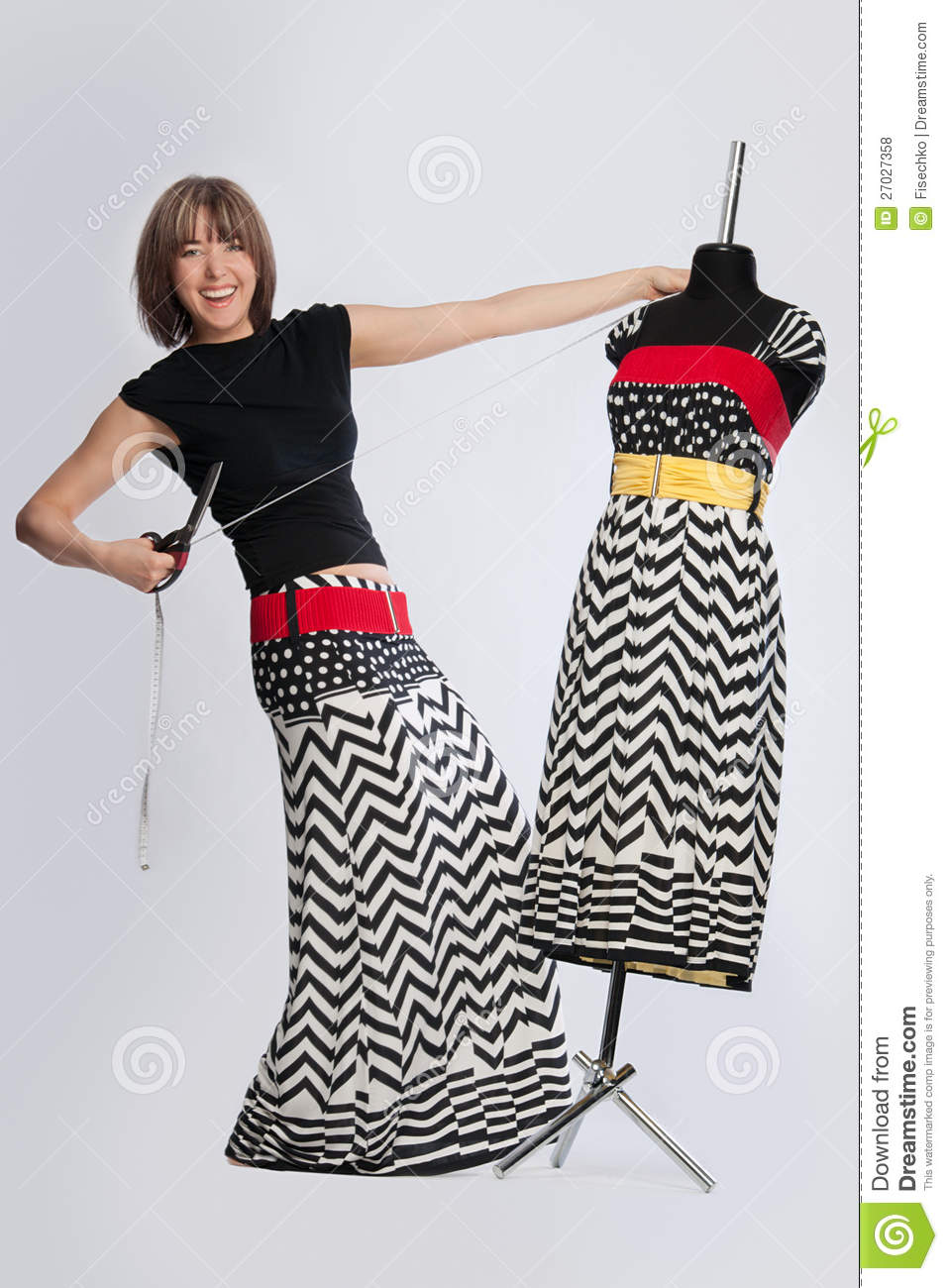 Fashion Designer Playing With Mannequin Royalty Free Stock
