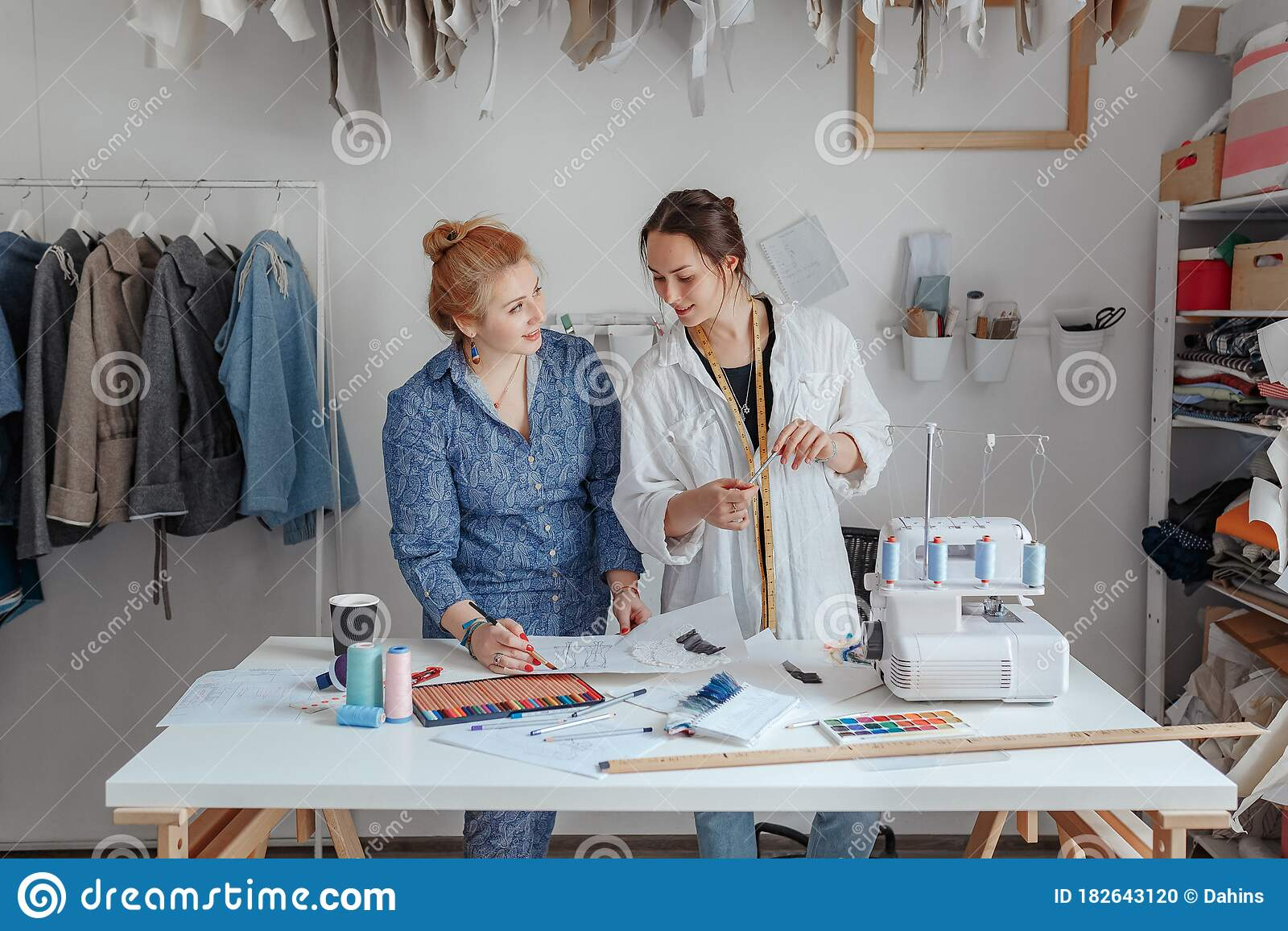 Fashion Designer Sewing Fabrics With Assistant Two Young Designers Work In A Bright Studio Have Opened Their Own Stock Photo Image Of Occupation Skill 182643120
