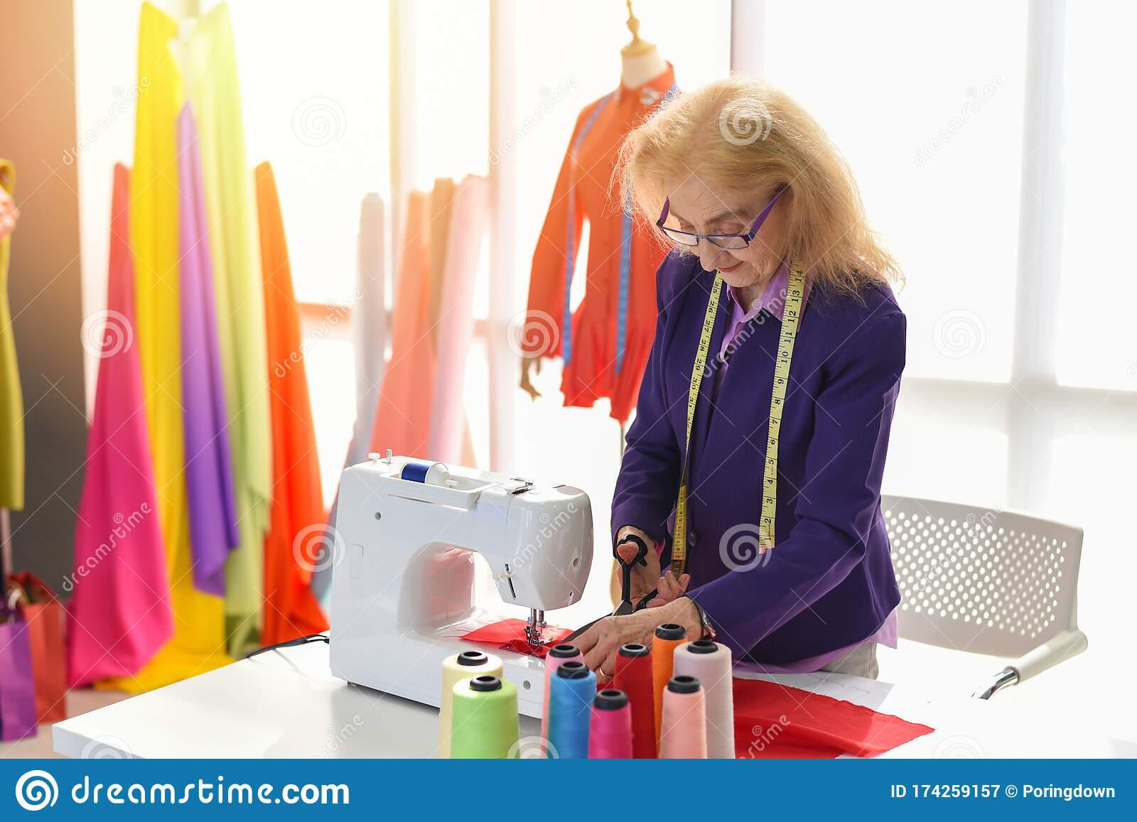 Fashion Designer Studio Measuring Textile Material Scissors Cutting Fabric By Senior Woman Designer Stylish Showroom Hanging Stock Image Image Of Collection Fabric 174259157