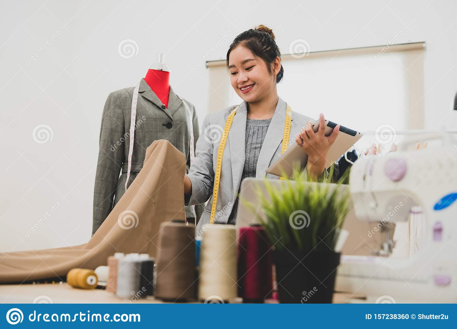 Fashion Designer Stylist In Business Owner Workshop With Tablet And Customer Contact List Tailor And Sew Concept Portrait Of Stock Photo Image Of Caucasian Fashion 157238360