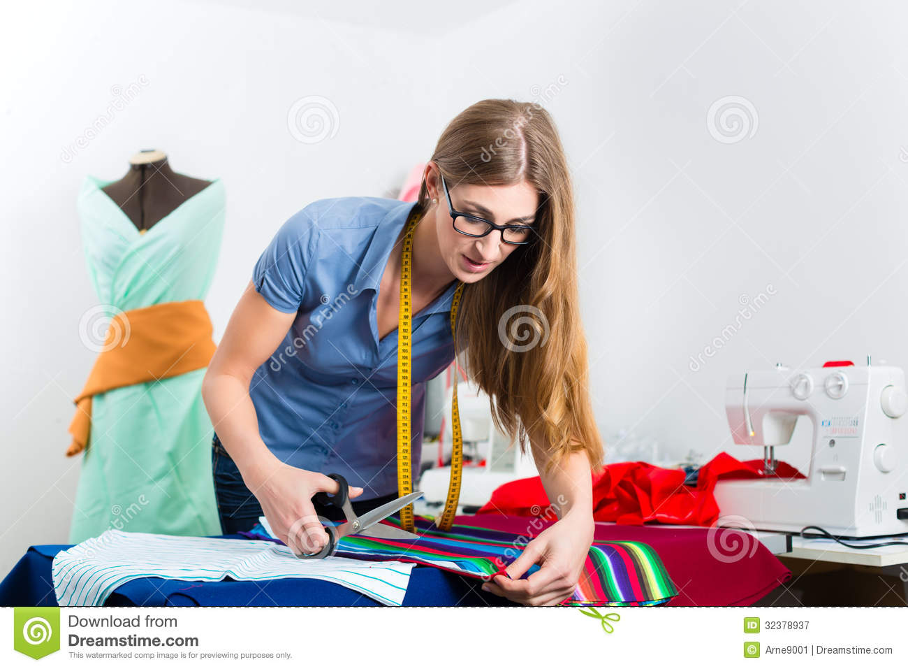 Fashion Designer Or Tailor Working In Studio Royalty Free