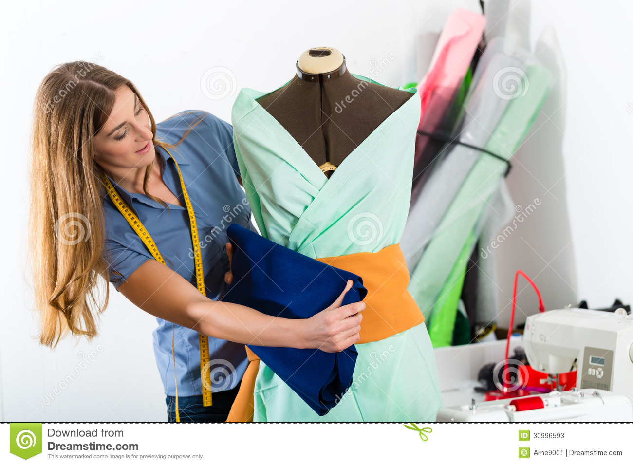 Fashion designer or tailor working in studio stock photos for To be a fashion designer