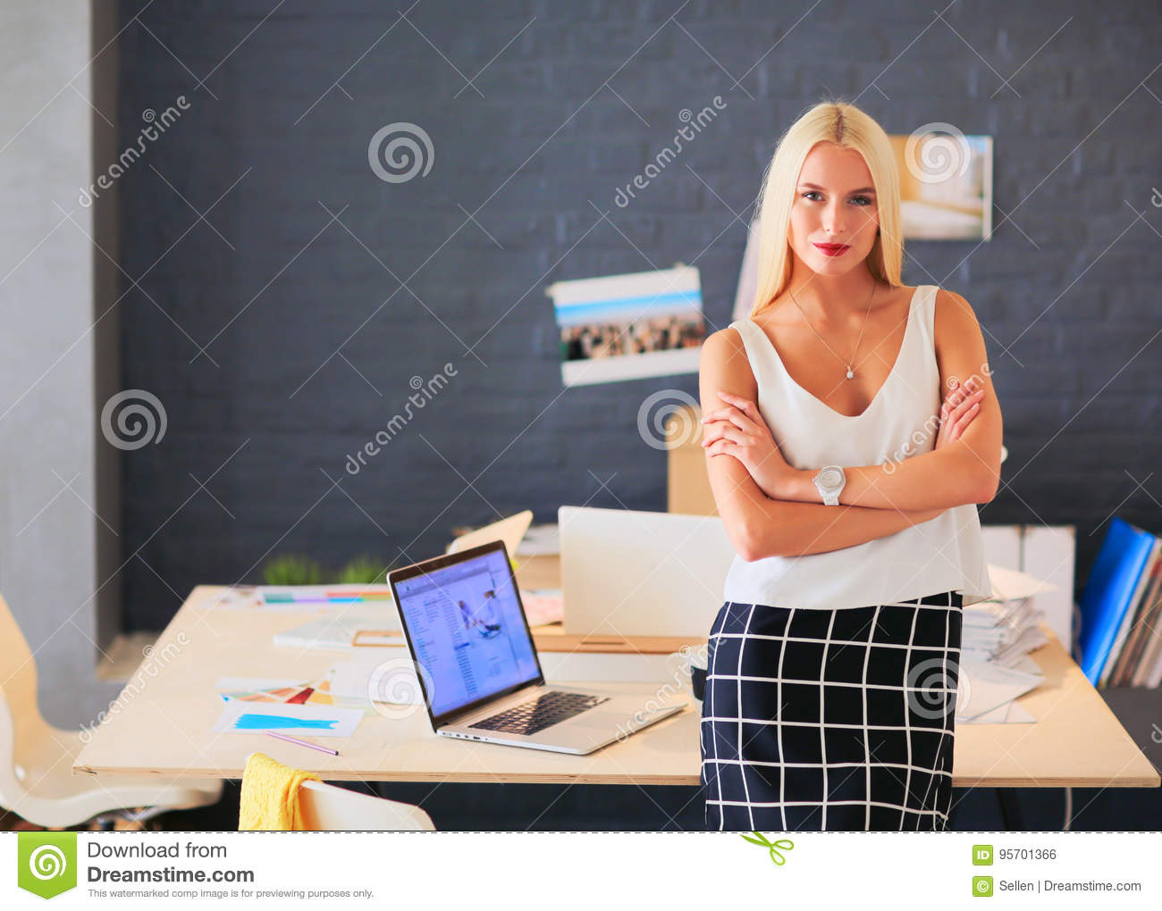 Female Fashion Designers Working At Desk Royalty-Free ...