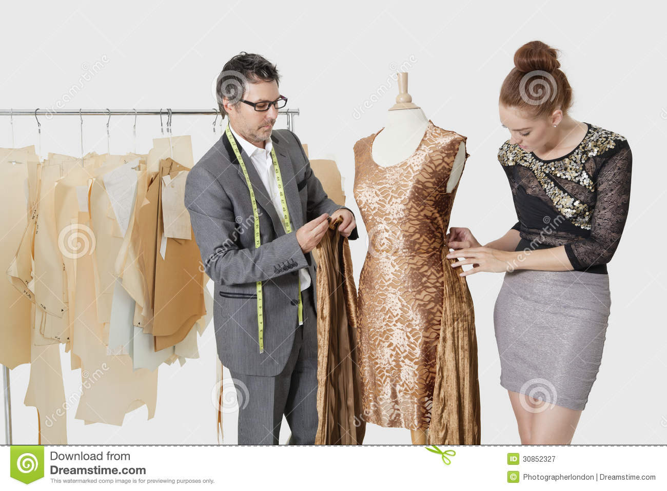 Fashion designers working together on an outfit in design Contemporary fashion designers