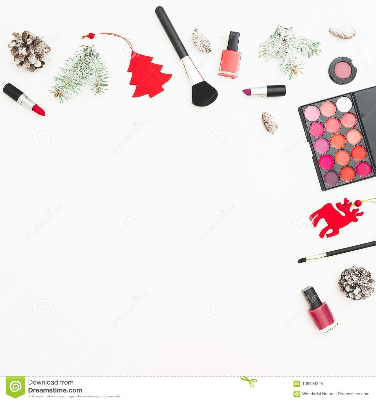 fashion desk with cosmetics accessories and christmas decoration confetti on white background flat