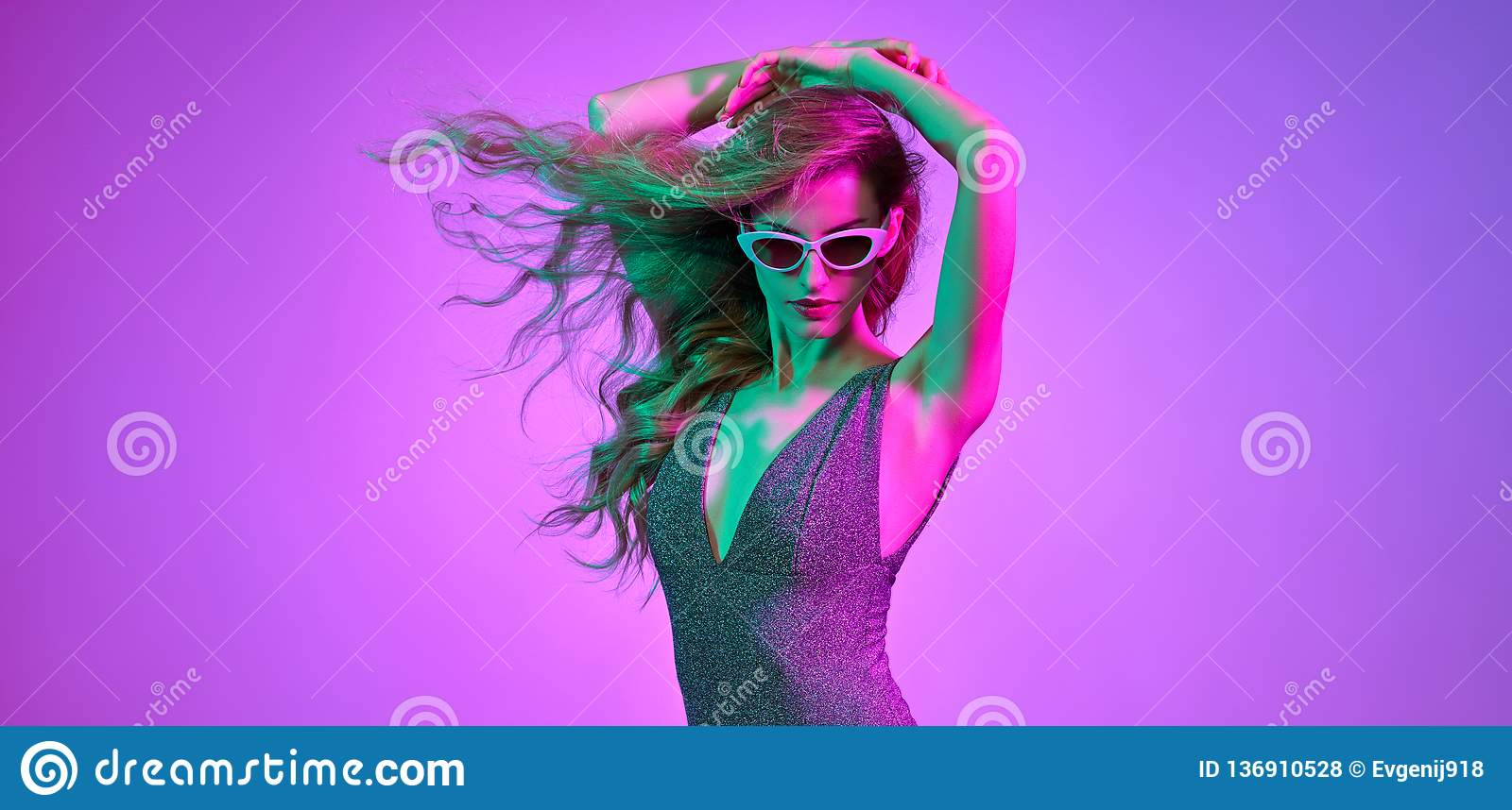 fashion. disco party girl dance in neon light stock photo