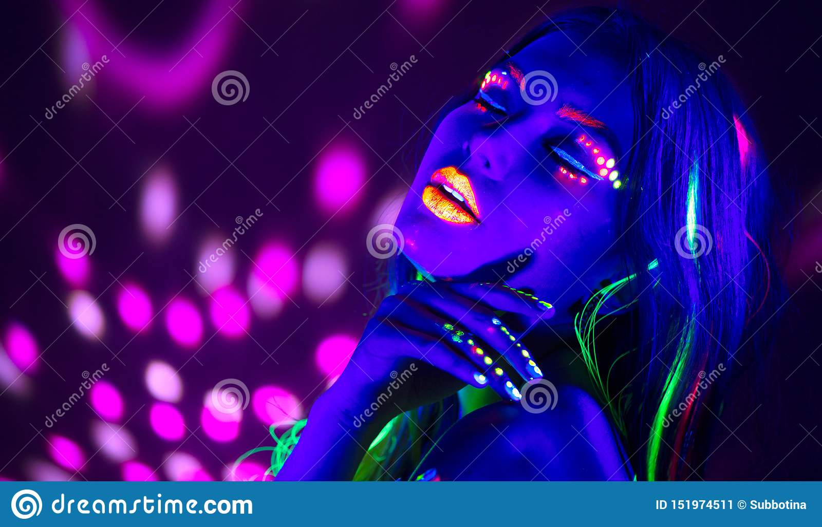Fashion disco woman. Dancing model in neon light, portrait of beauty girl with fluorescent makeup