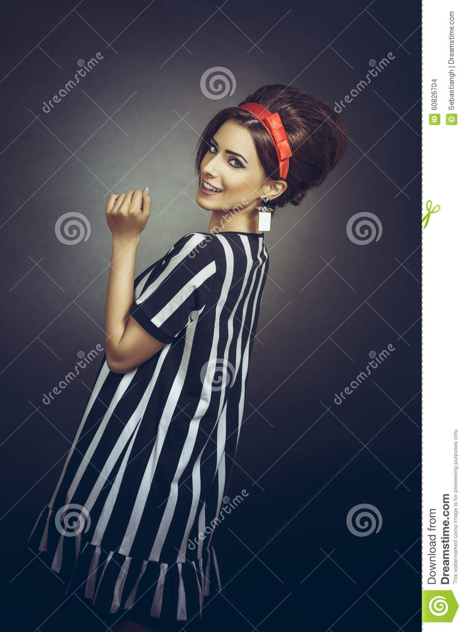 Beautiful Joyful Young Fashion Female Model Wearing Vintage Black And White Stripped Outfit Red Headband Large Earrings Looking Back Over Her Shoulder