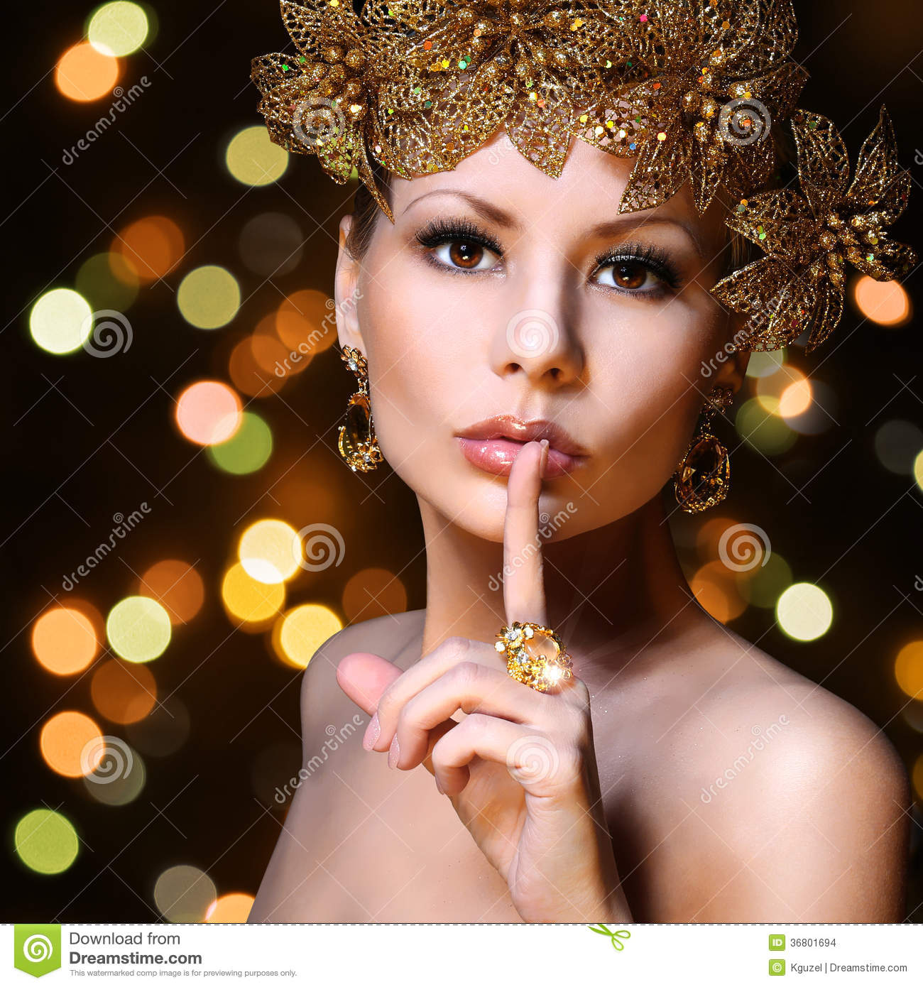 Fashion Girl with Gold Jewelries over bokeh background. Beauty