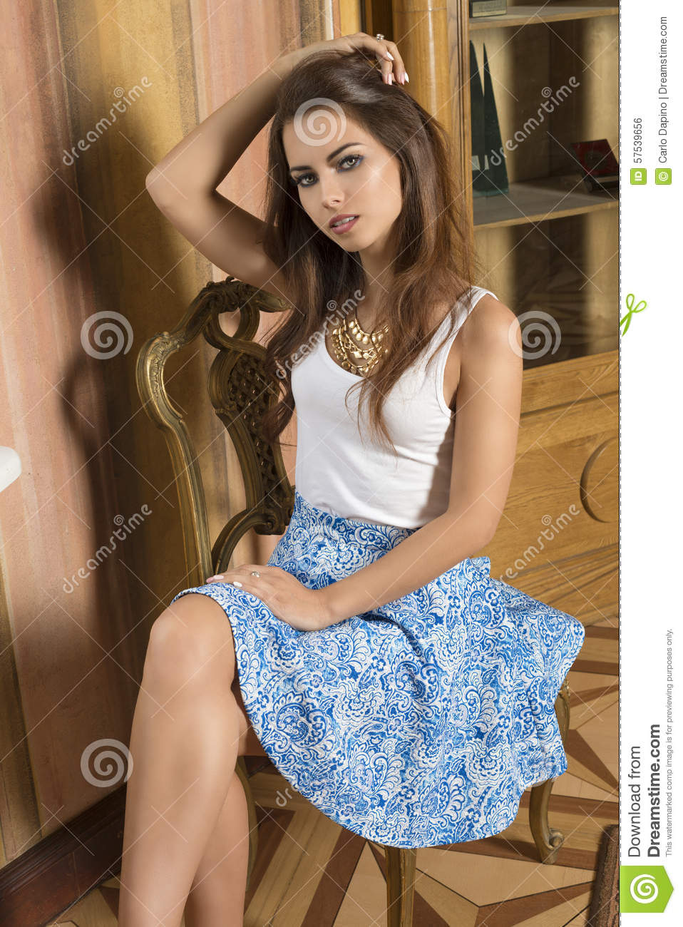 fashion girl sitting on old chair stock photo image