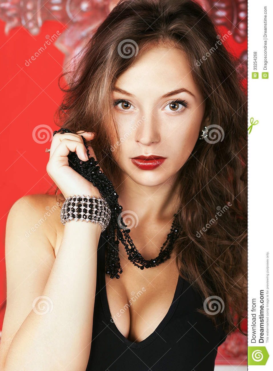 Fashion Glamour Girl With Jewellery On Red Vintage