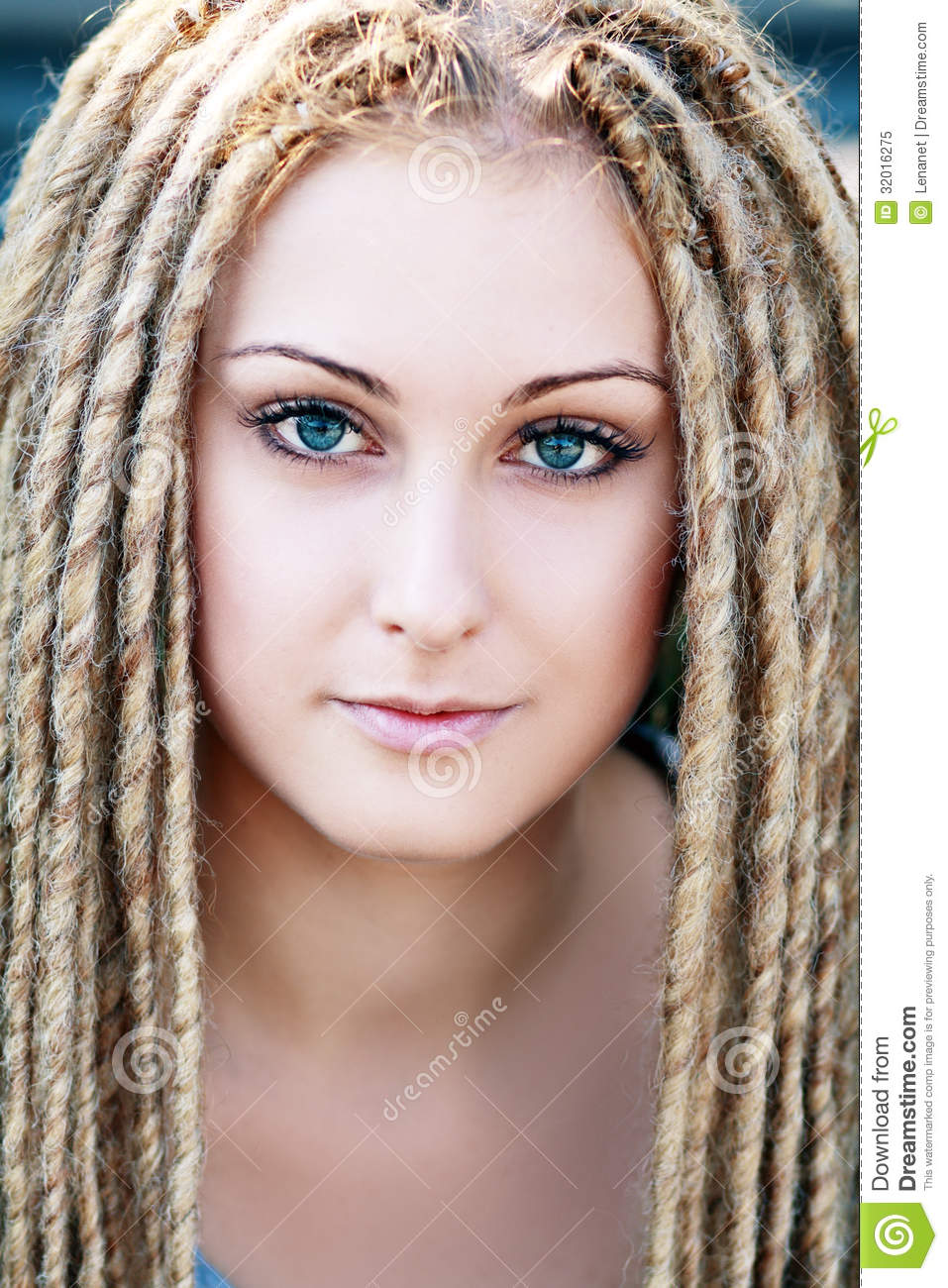 Dreadlocks. Fashion hairstyle with dreads  beauty woman face.