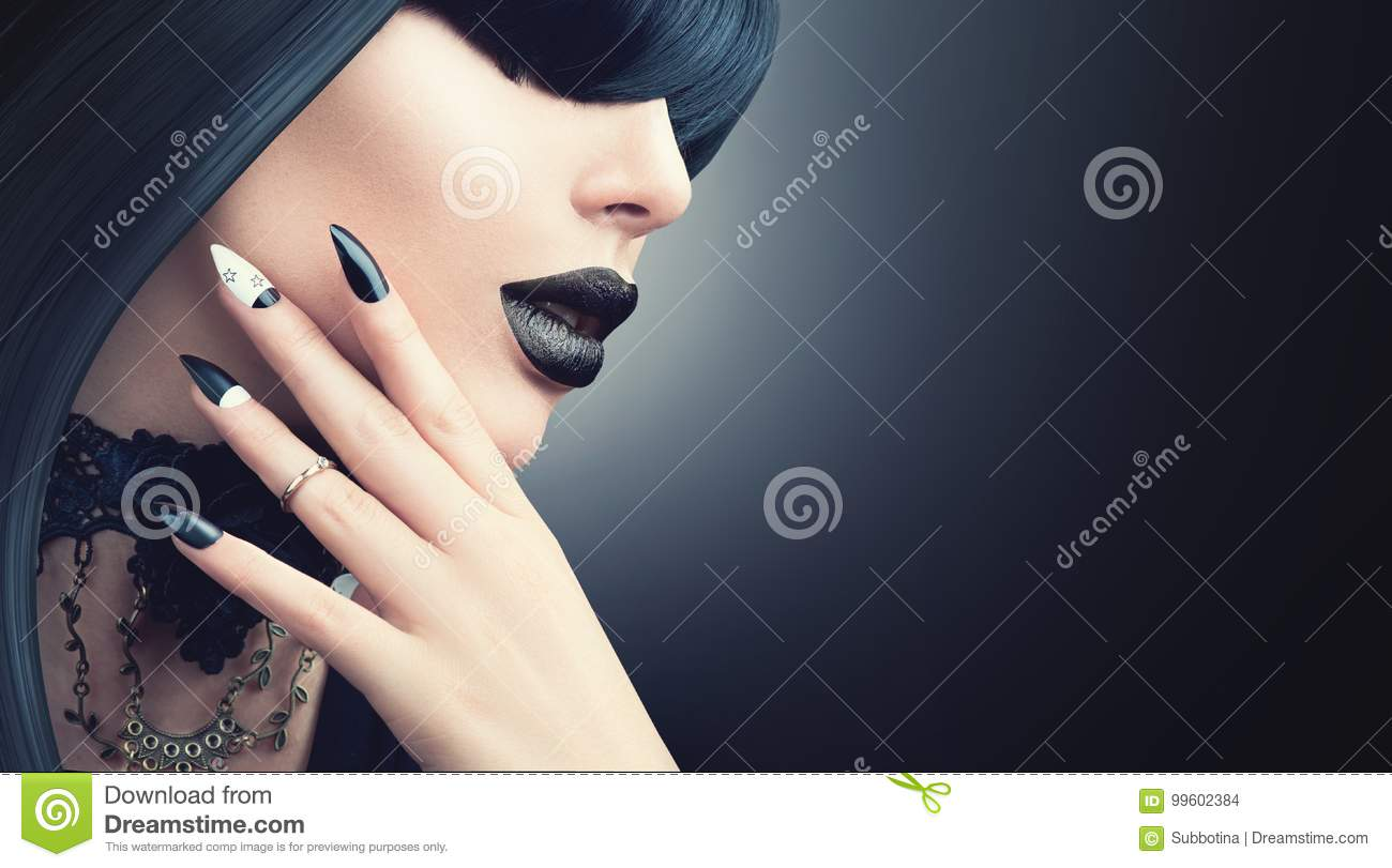 Fashion Halloween model girl with gothic black hairstyle, makeup and manicure