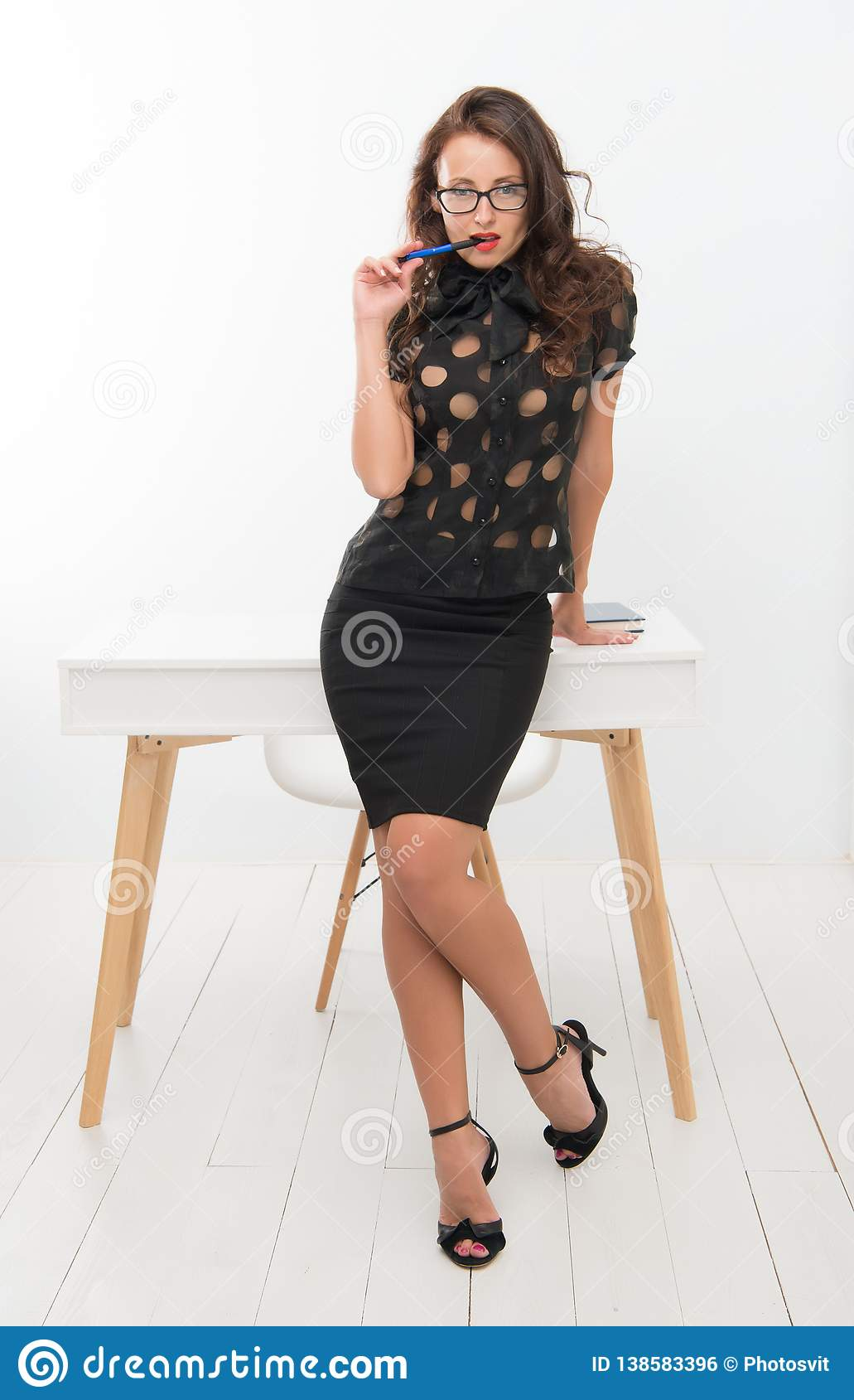 Fashion is her life. businesswoman. Pretty school teacher or student. Business school coach. Dress code. Fashion