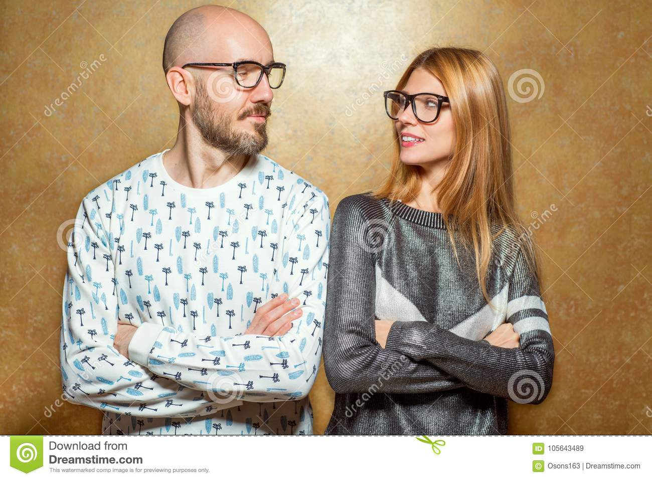 8058ff2da2e Fashion Hipster Couple In Love In Glasses Posing On A Gold Backg ...