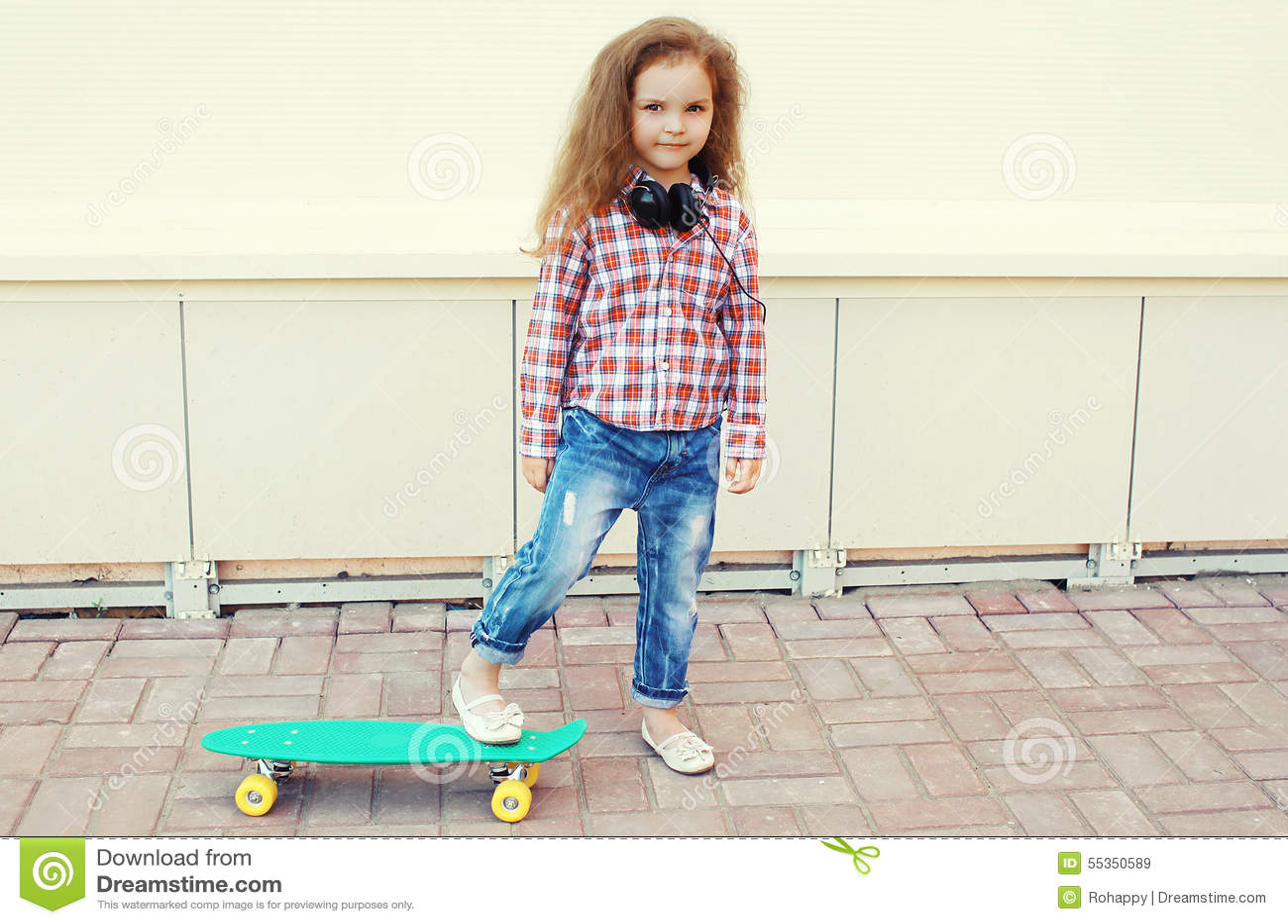 Fashion kid. Stylish little girl child with skateboard