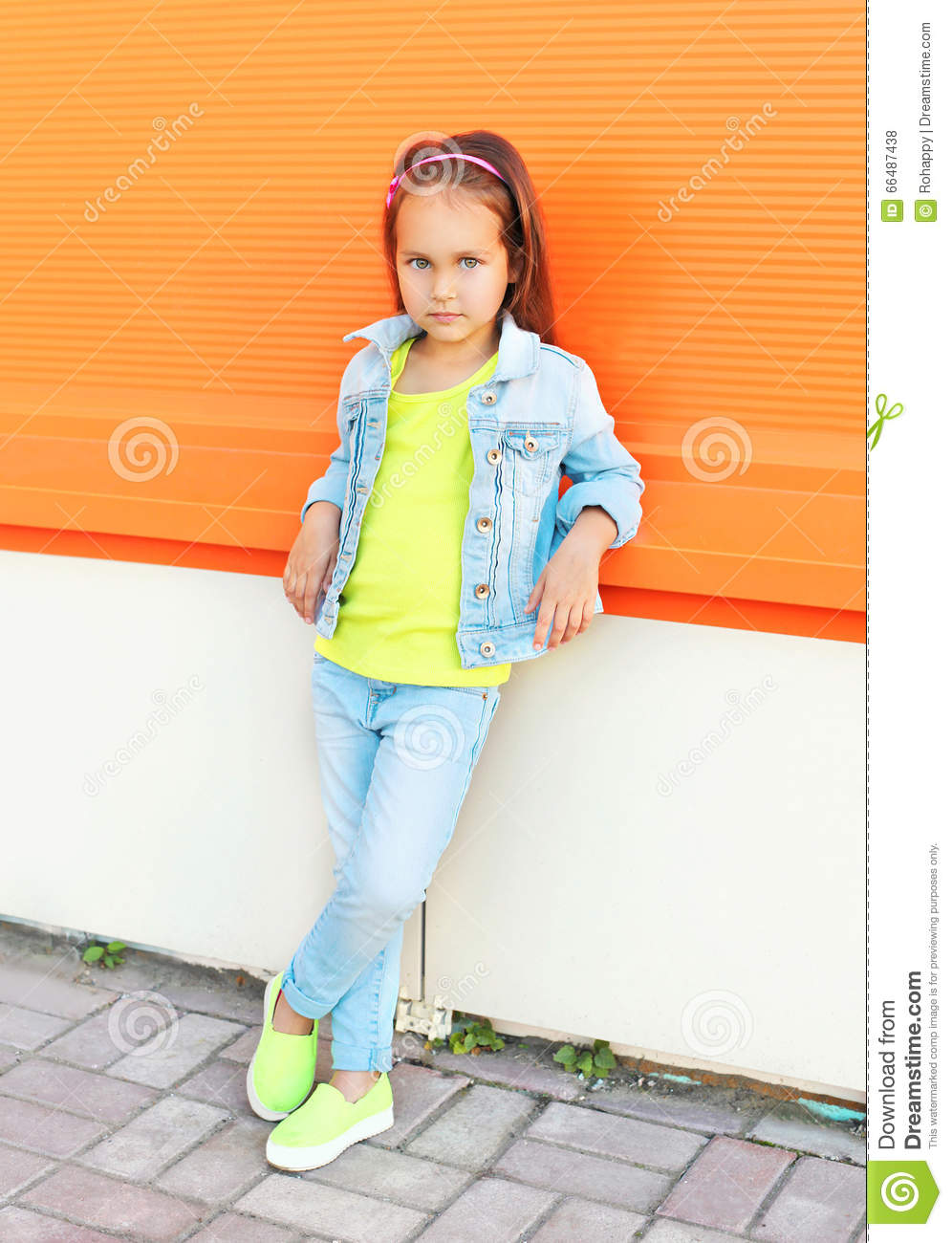 Fashion Little Girl Child Wearing A Jeans Clothes Stock